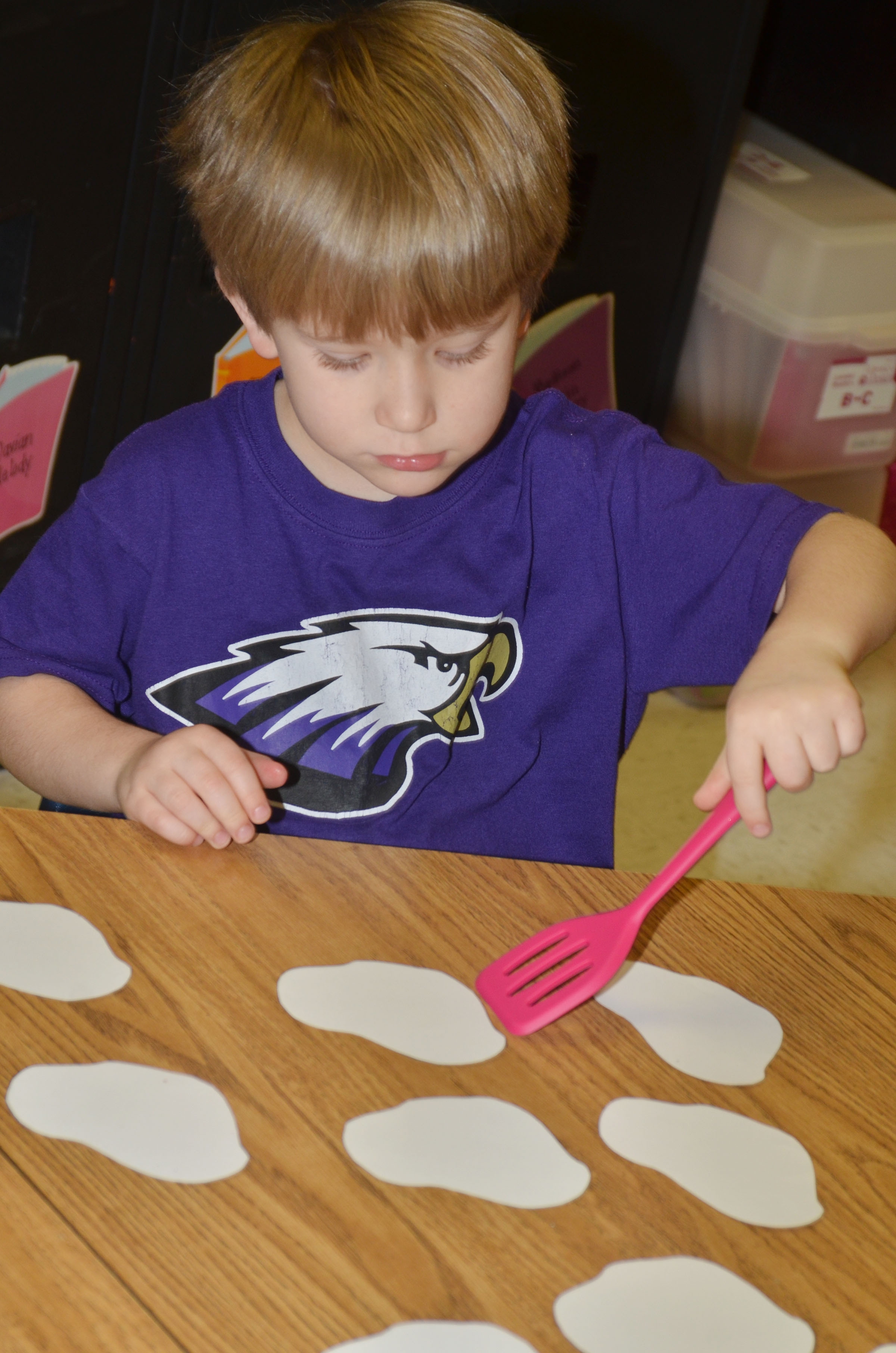 CES kindergartener Luke Banta flips over a word with his spatula.
