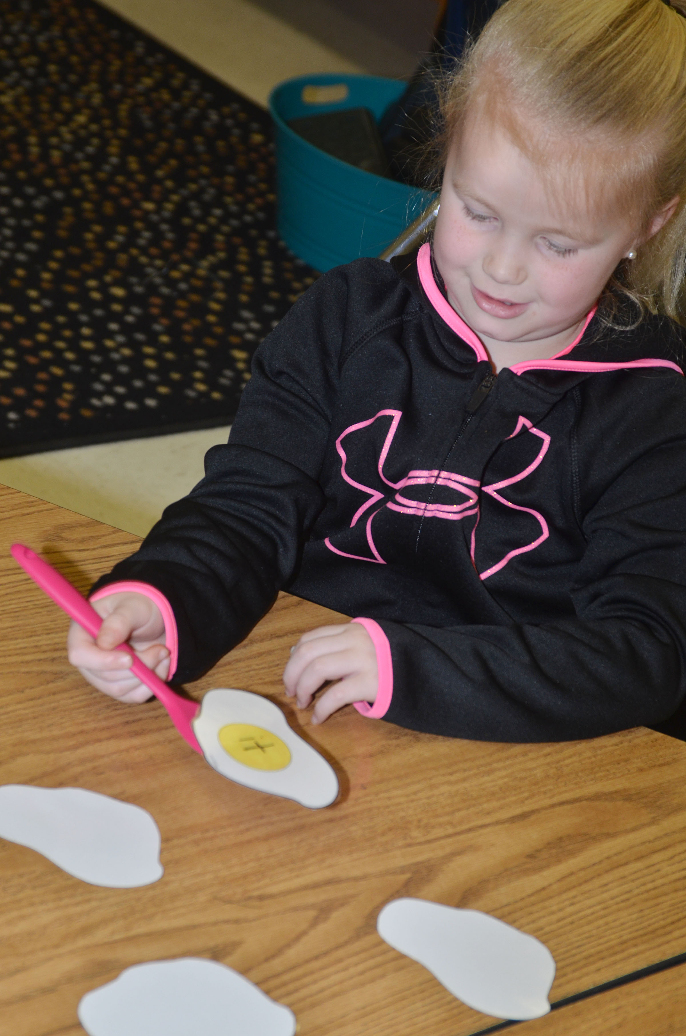 "CES kindergartener Lillie Judd flips over the word ""it"" with her spatula."