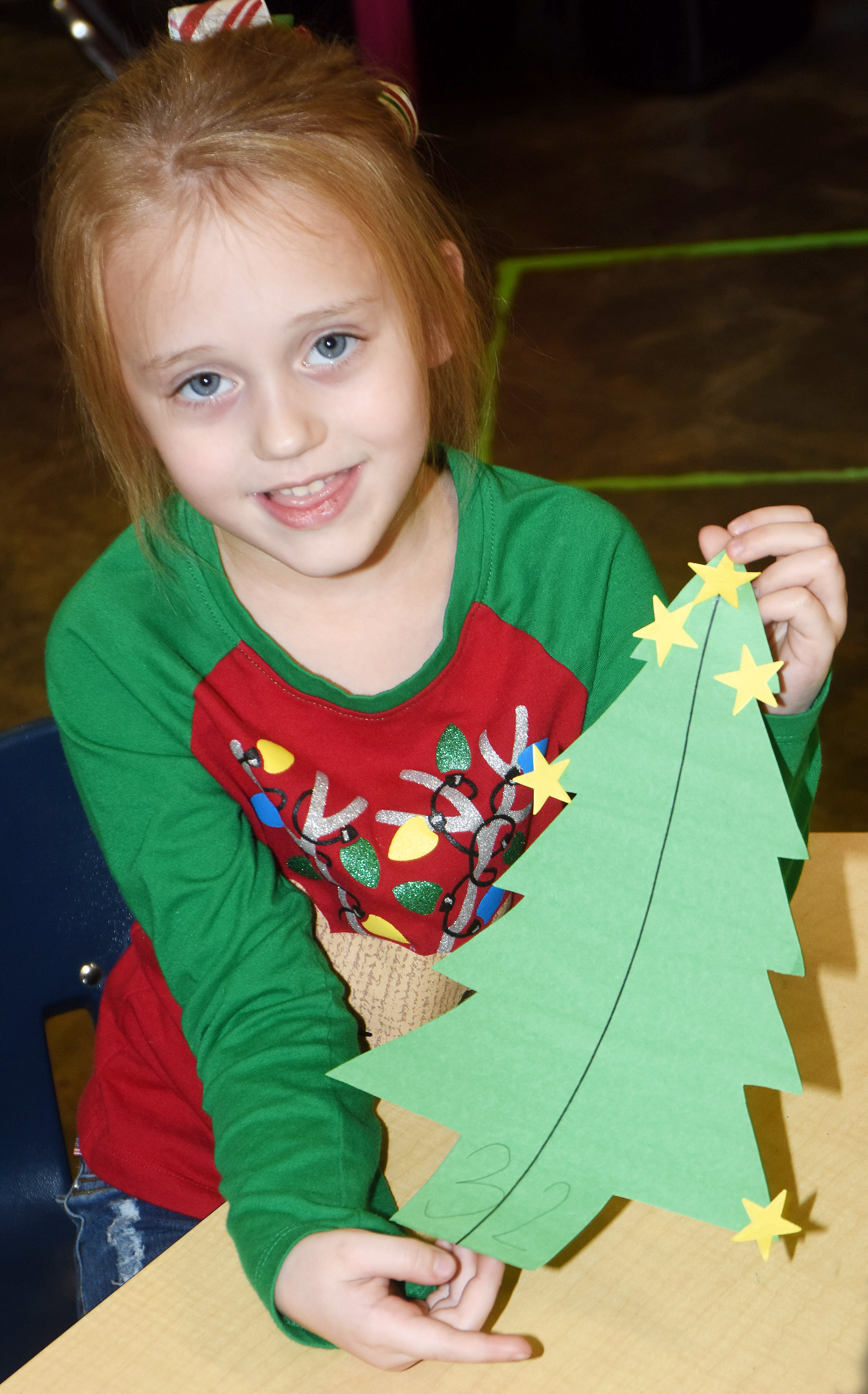 CES kindergartener Kylie Thompson holds her Christmas tree.