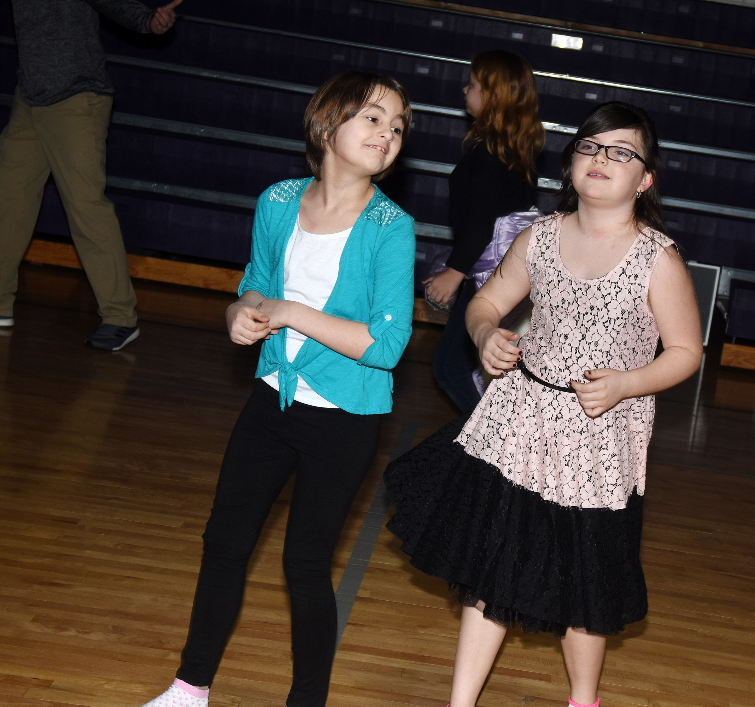 CES fourth-graders Raeanna Jefferson, at left, and Lauren Pace have fun at the dance.