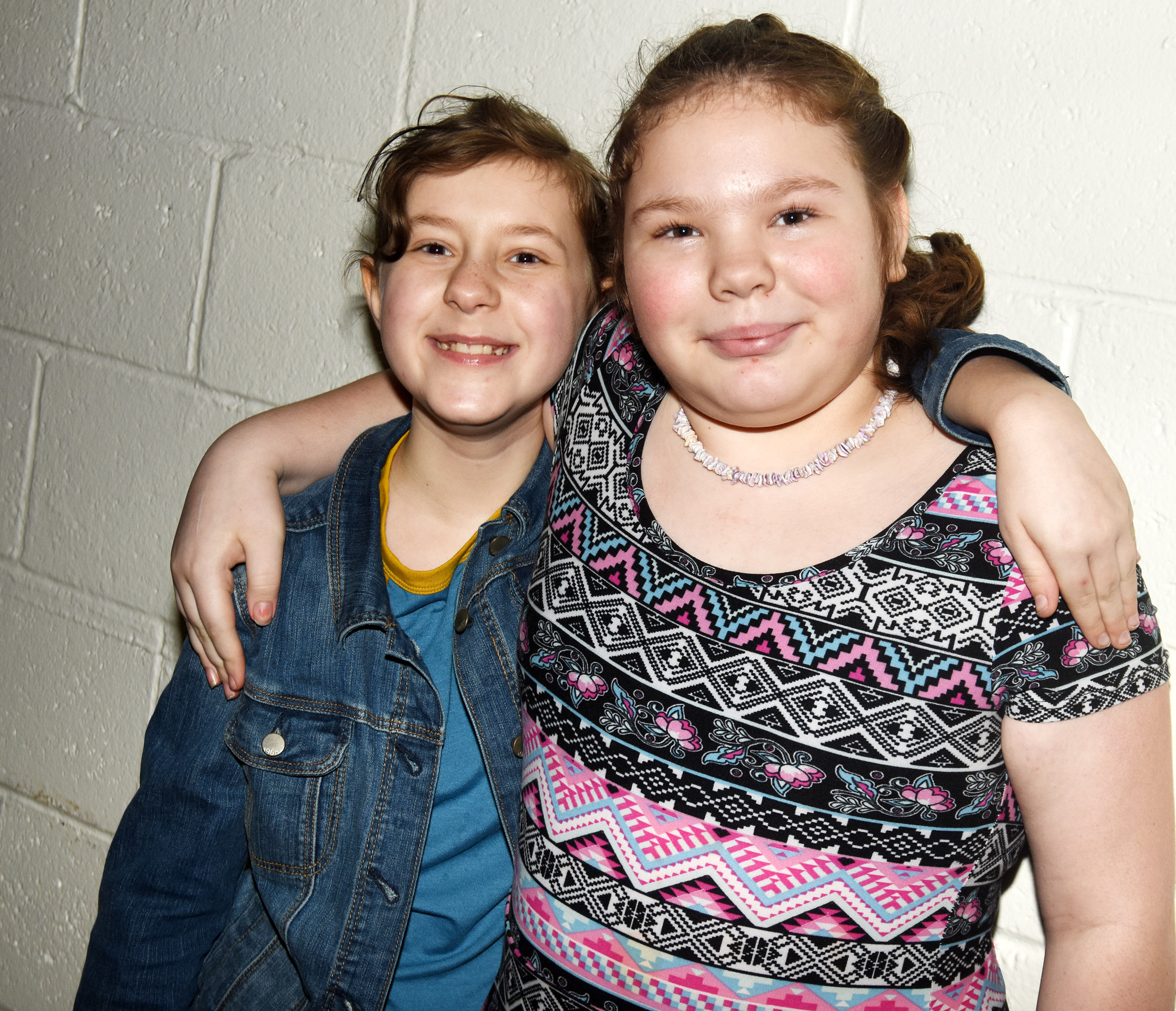 CES fifth-graders Bryanna Fitzgerald, at left, and Averi Perkins smile for a photo together at the dance.