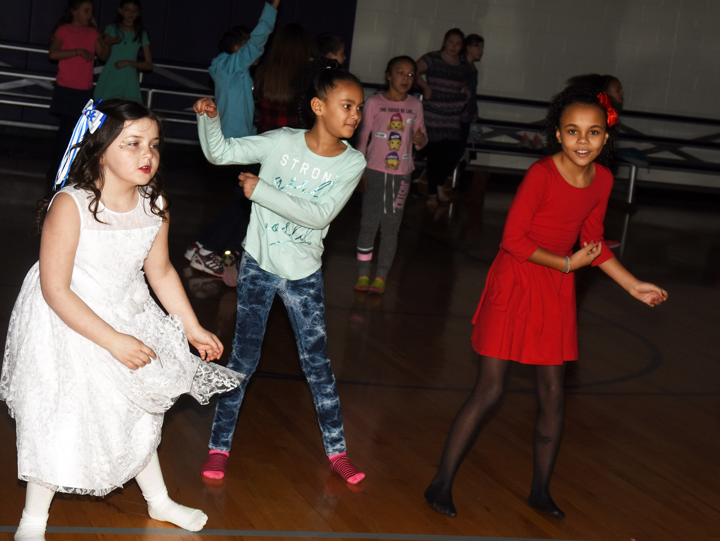 CES students dance. From left are third-graders Kendall Cruz, Alexia Howard and Braelyn Taylor.