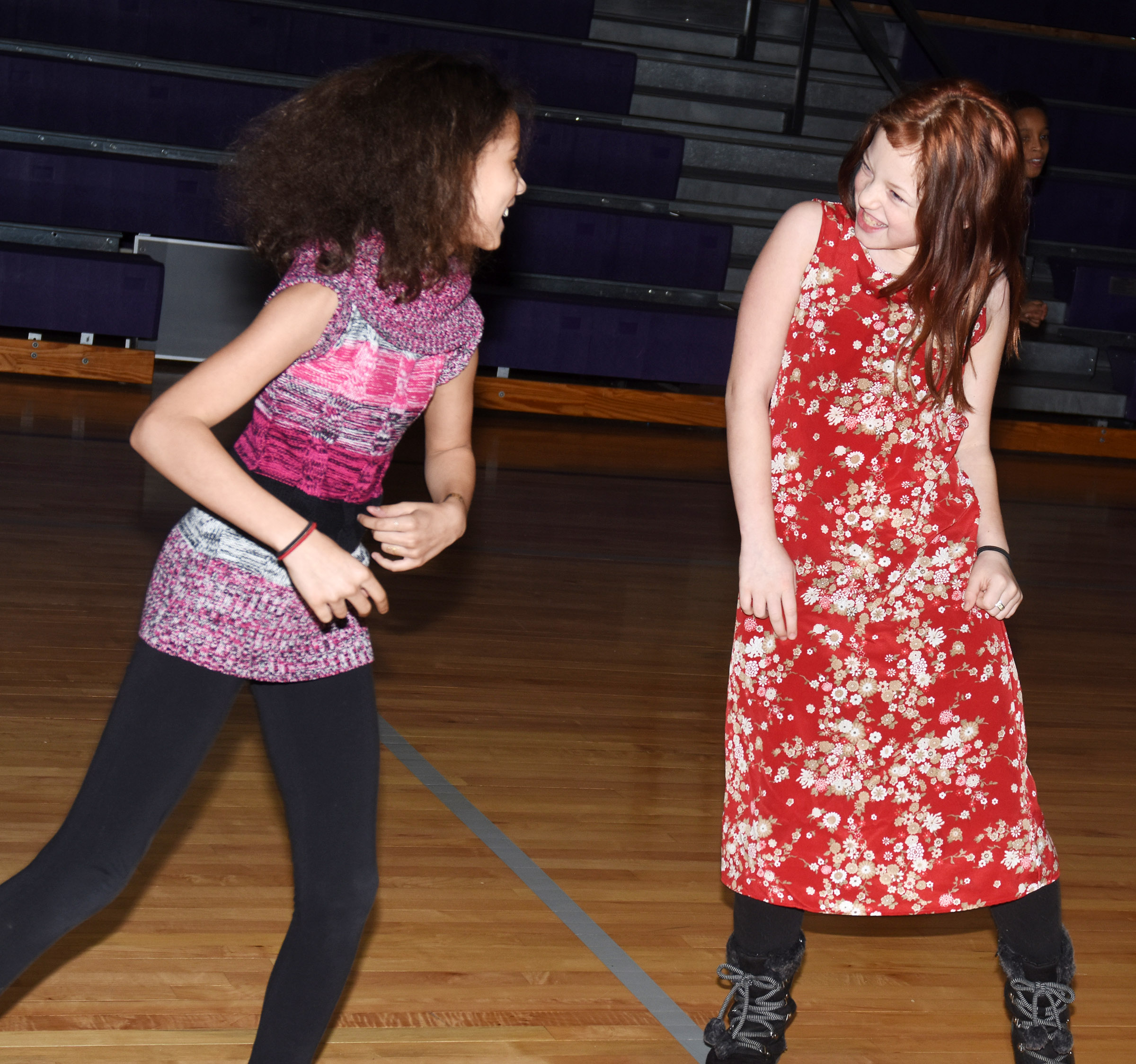 CES fifth-graders Mackenzie Negron, at left, and Kyra Parker dance.
