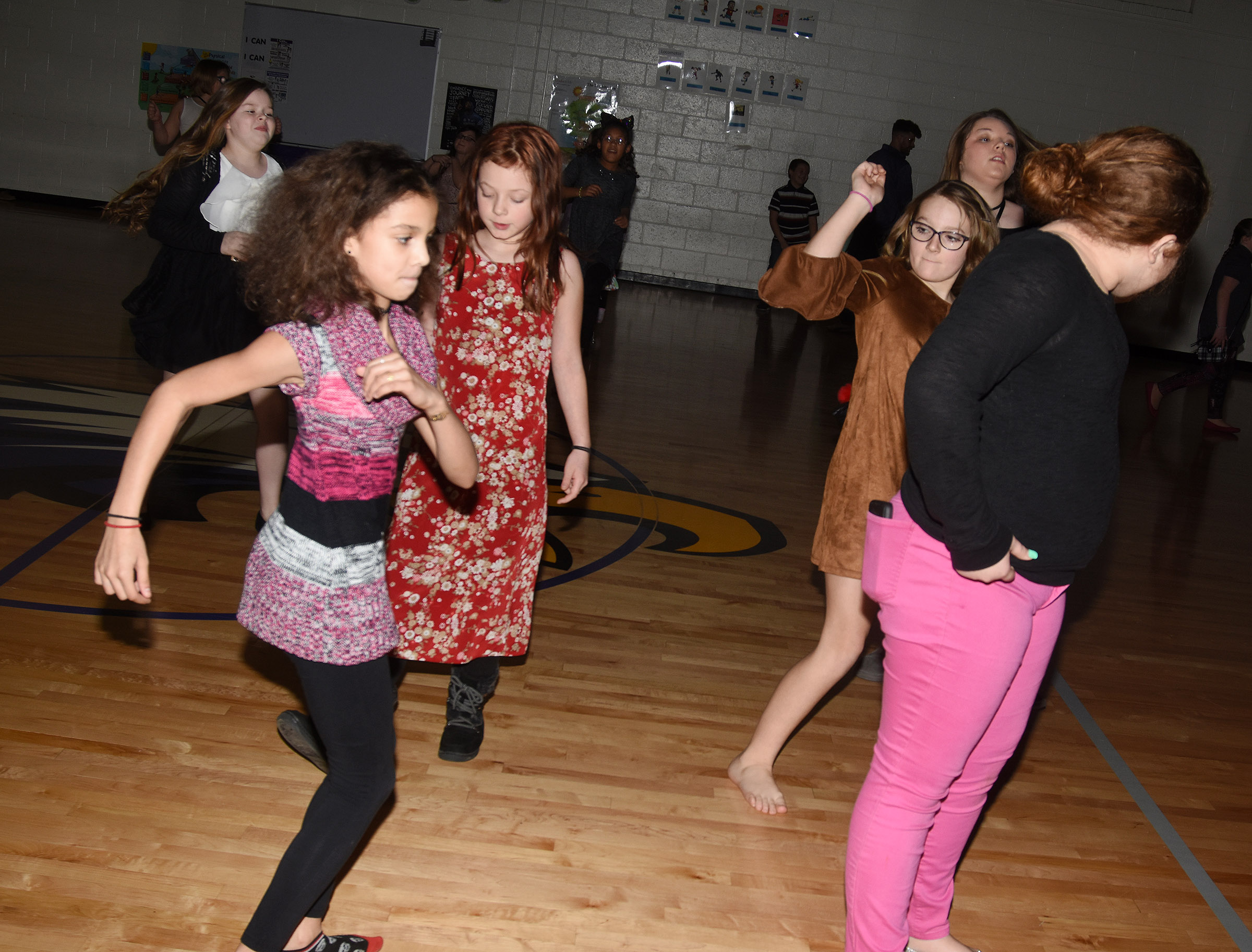 CES students dance together.
