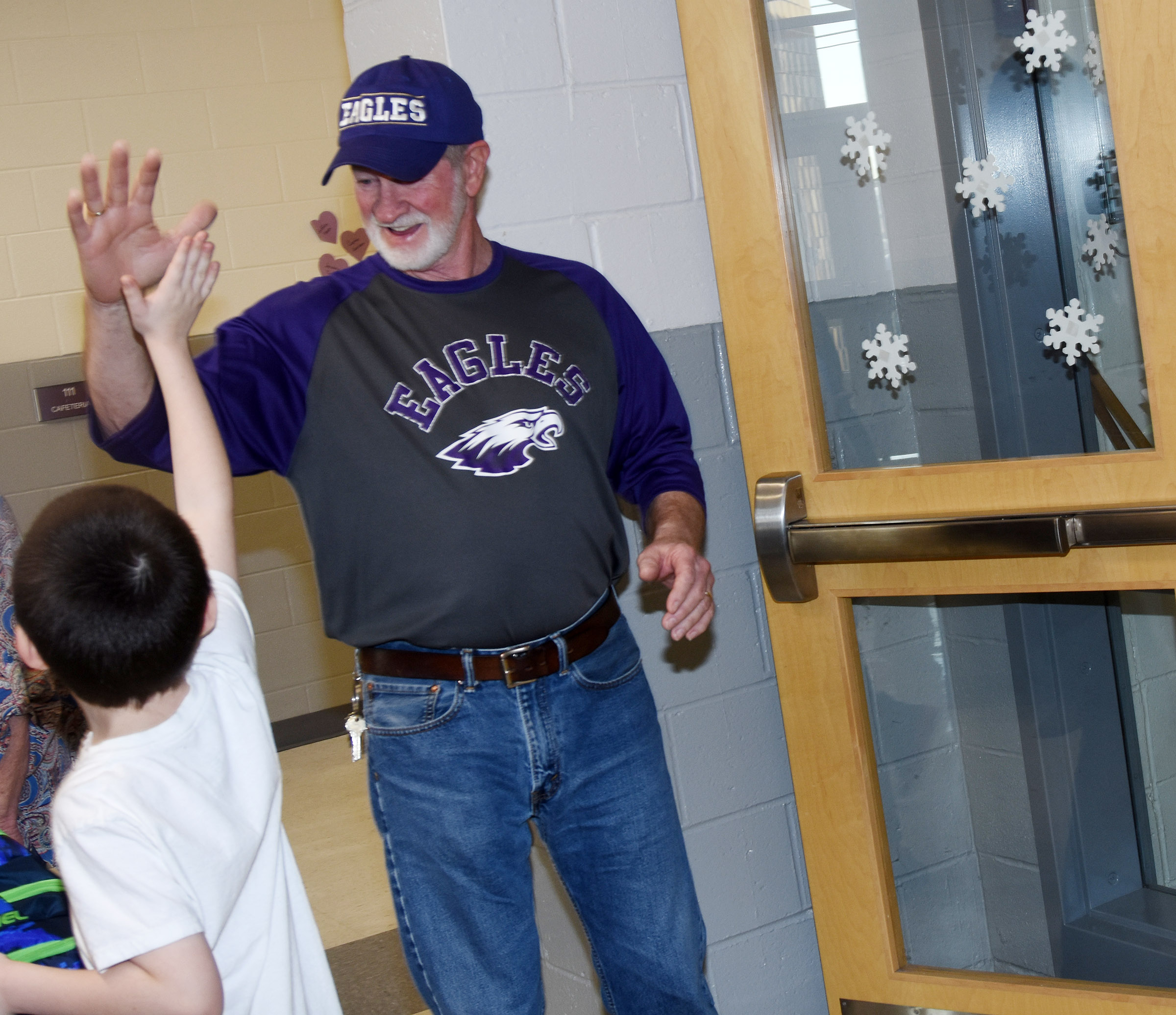 CES custodian Daryl Ford, who is retiring after working for Campbellsville Independent Schools for nearly 30 years, gets hugs and high-fives from students.