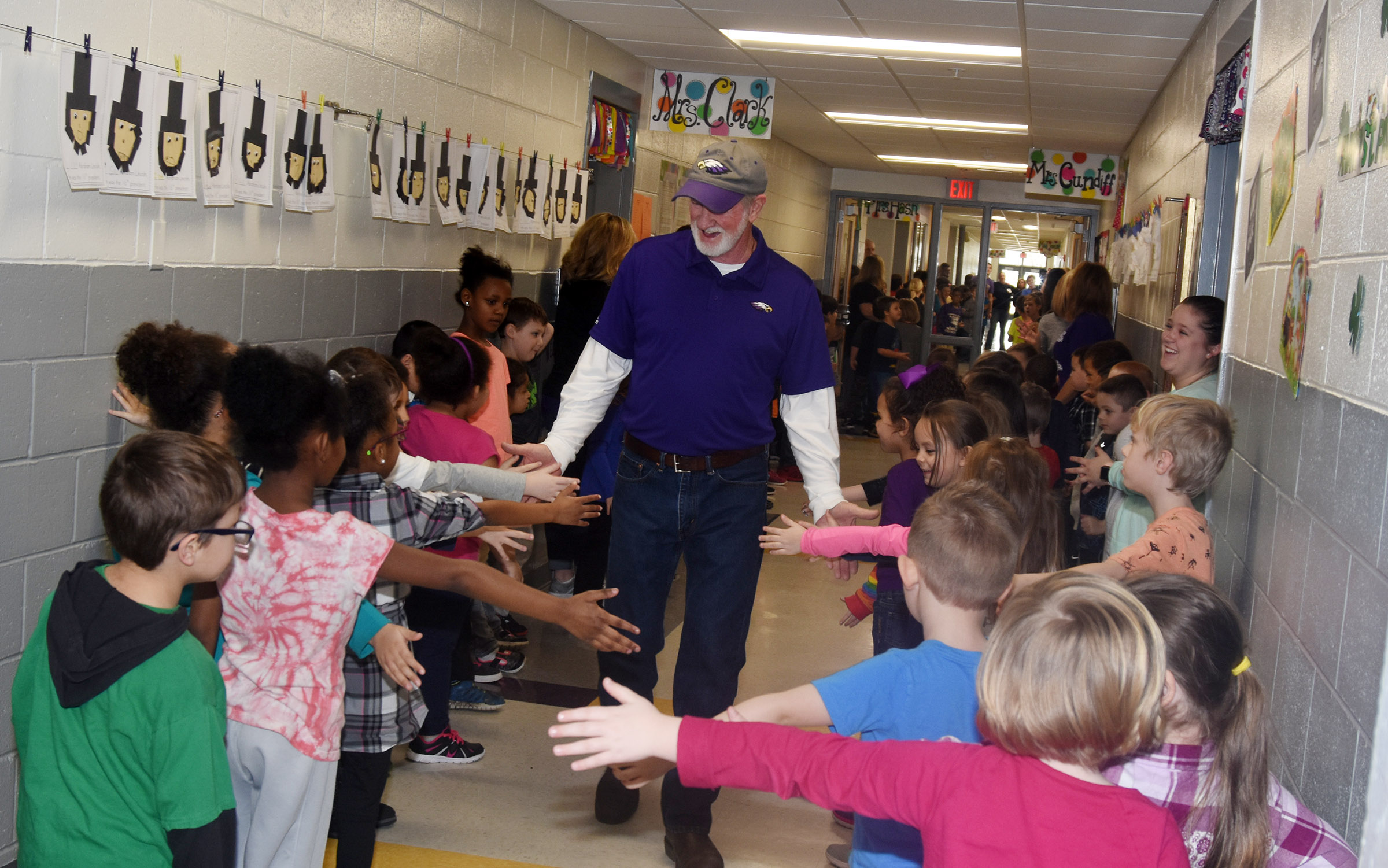 CES custodian Daryl Ford is honored with an Eagle Walk on Wednesday, Feb. 28, which was his last day of work before retirement.