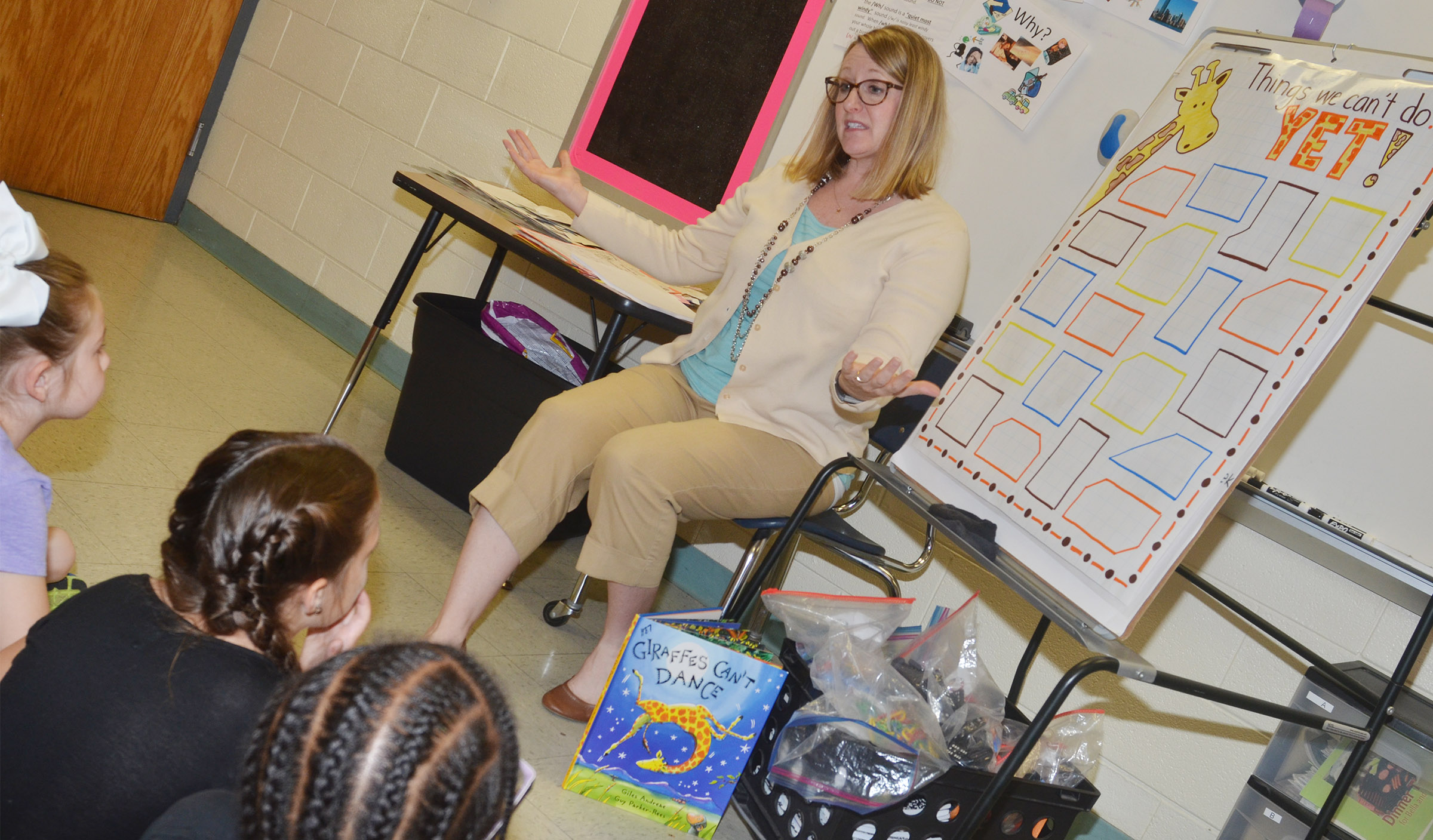 CES reading interventionist Laura Dicken talks to students about staying motivated, even though there are several activities they can't do just yet, but will learn to as they grow older.