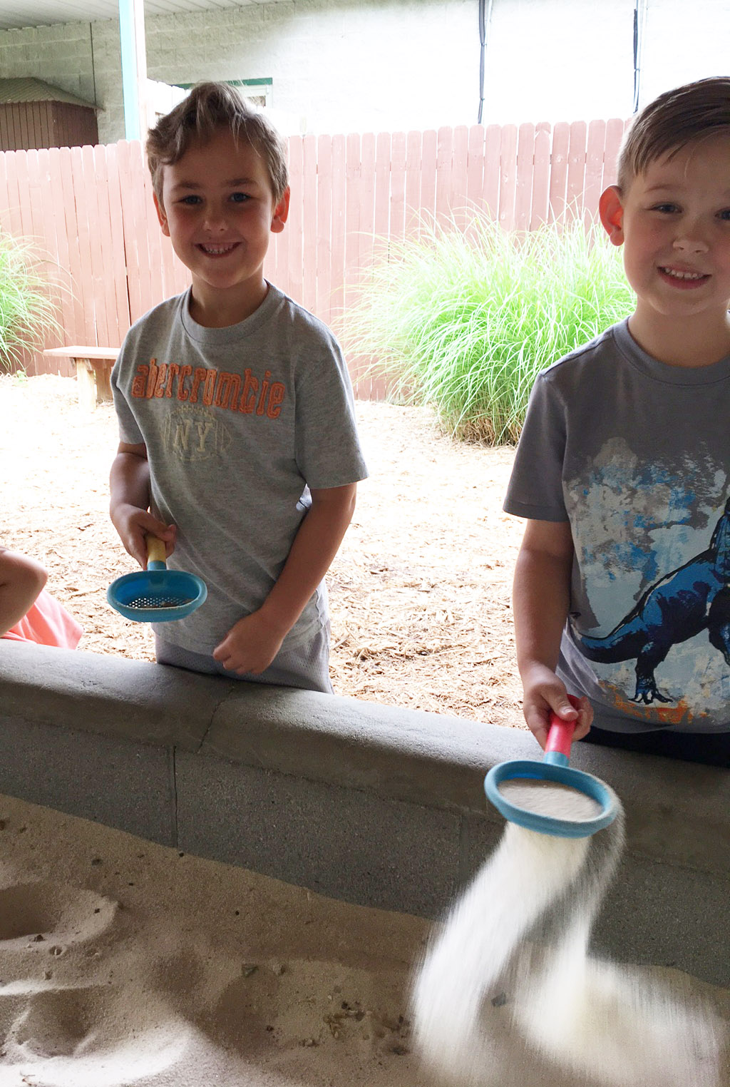 CES kindergarteners Braxton Rhodes, at left, and John Hagan Newton dig for fossils.