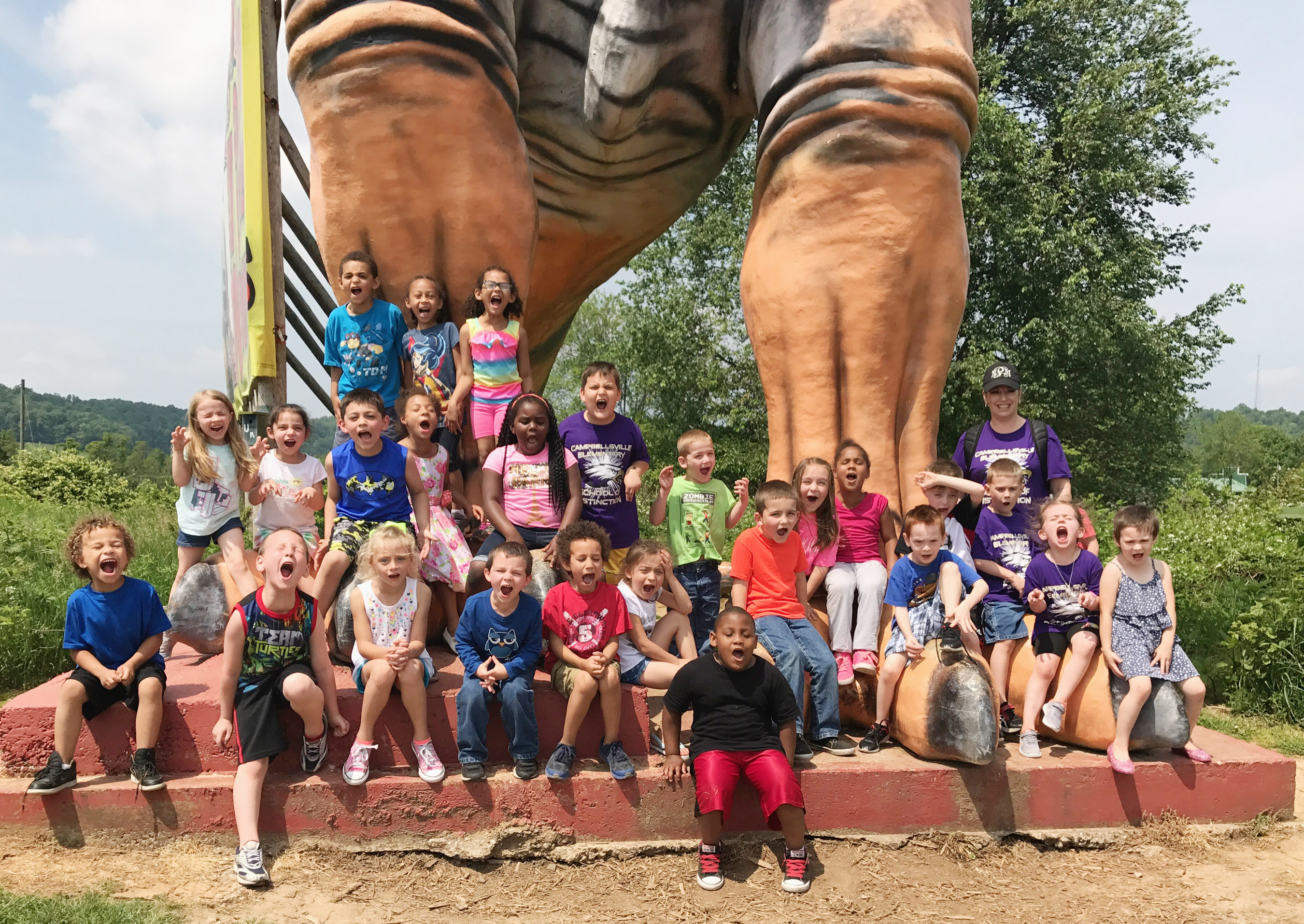 CES kindergarteners in Nikki Price's class pose for a photo at Dinosaur World.