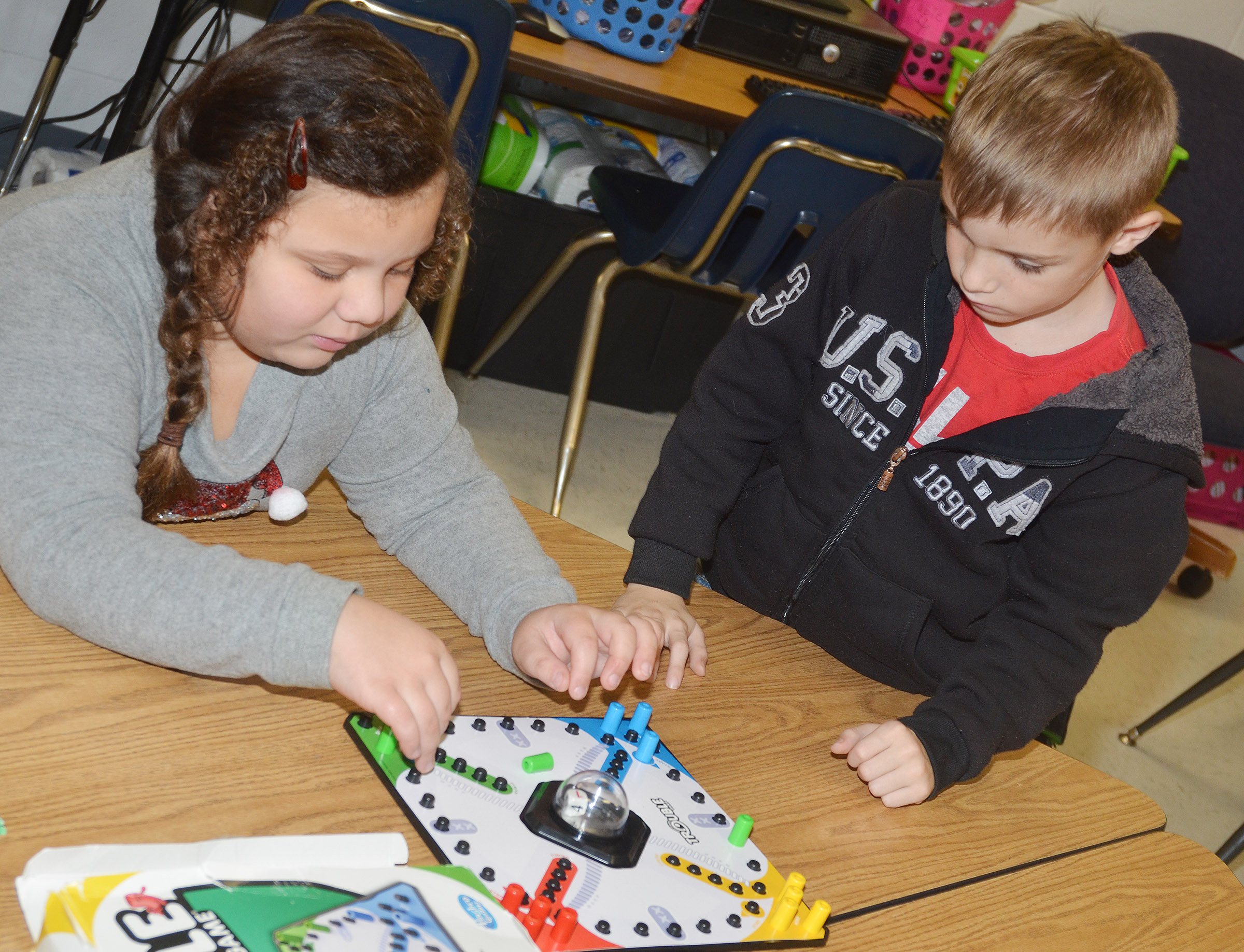 CES second-graders Amylah Taylor, at left, and Ben Lord play Trouble.