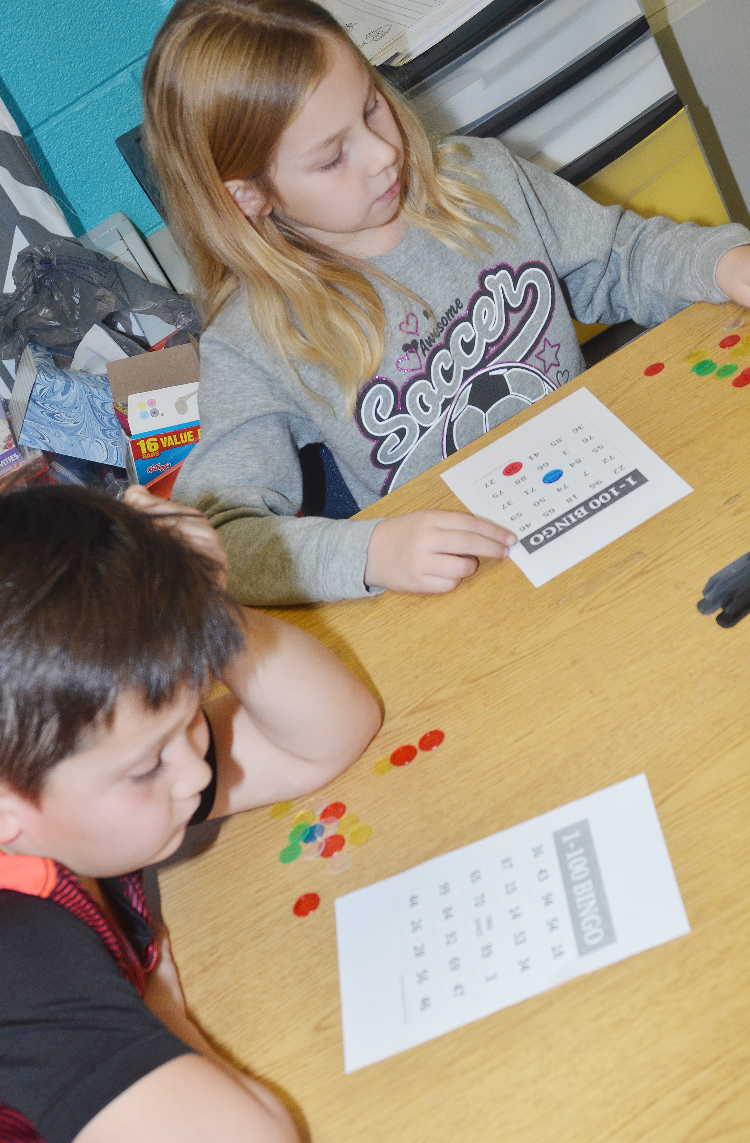 CES first-graders Karter Young, at left, and Kira Dotson play bingo.