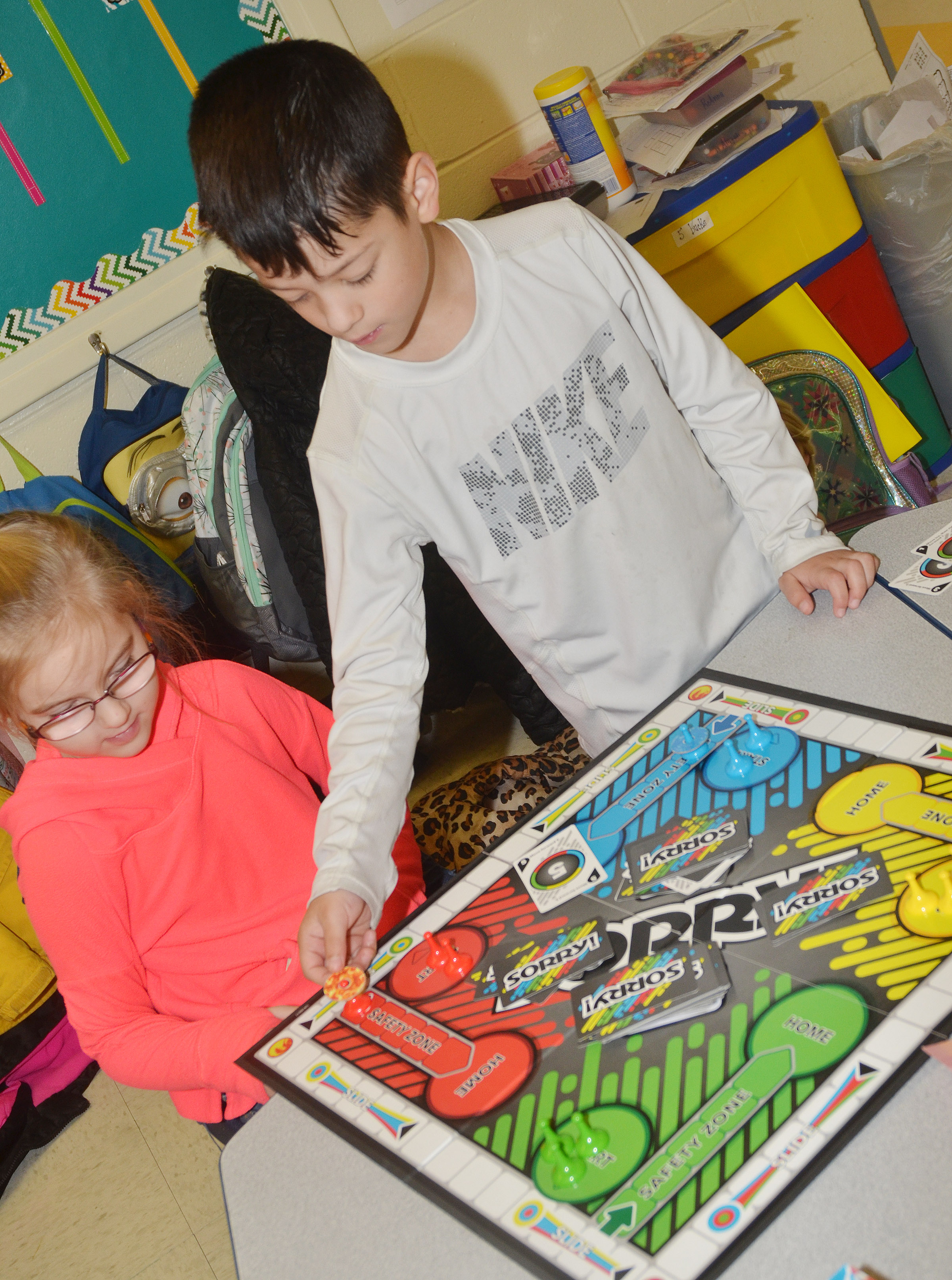 CES first-graders Jaden Lutz, at left, and Abram Adkins play a game of Sorry!