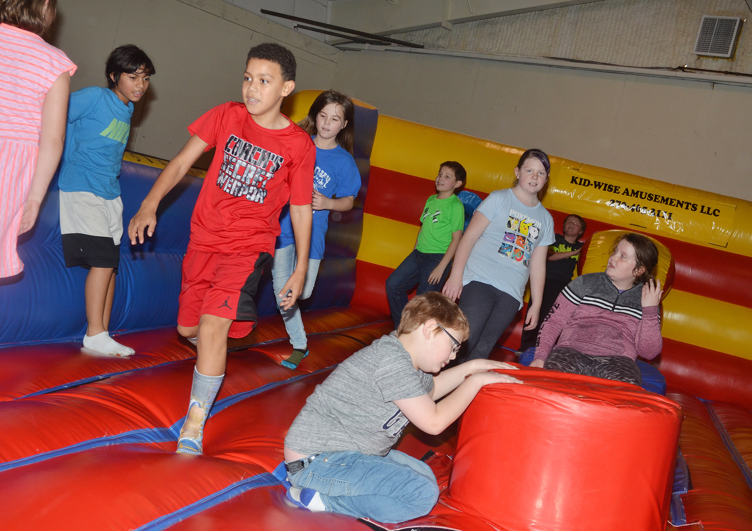 CES fourth-graders jump on an inflatable.