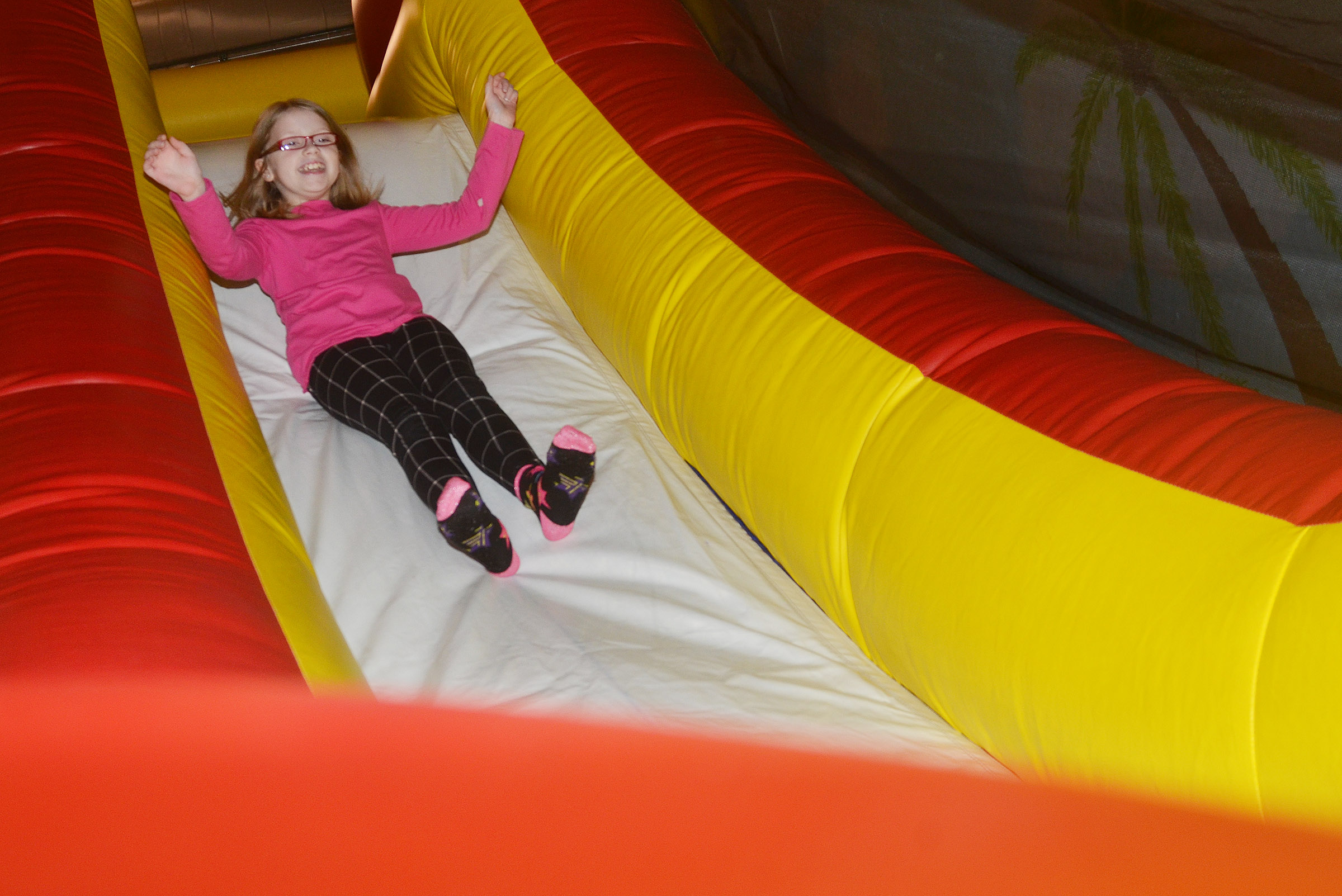 CES fourth-grader Gracie Pendleton slides down an inflatable.