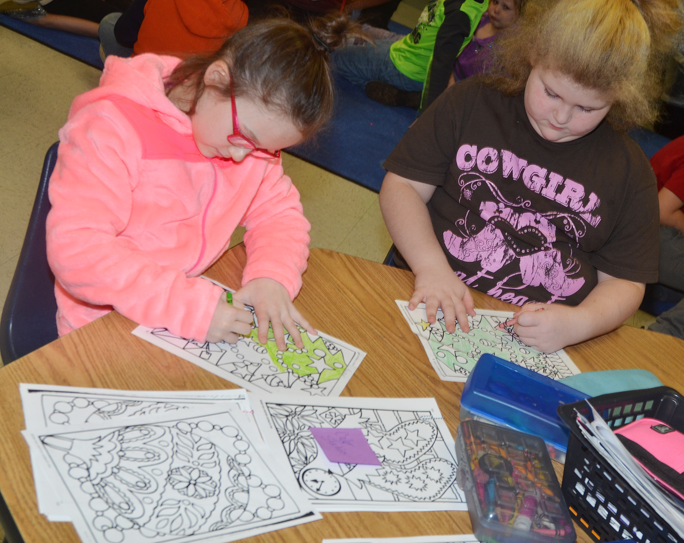 CES second-graders Anna Keith, at left, and Elizabeth Foster color.