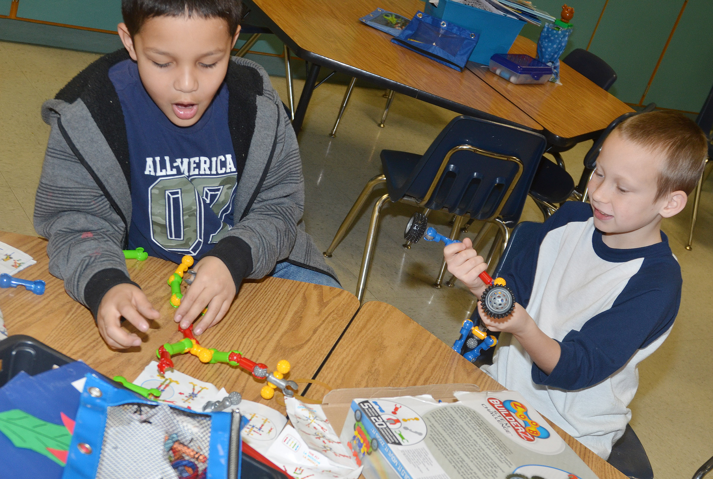 CES second-graders Makyian Bridgewater, at left, and Raleigh Spencer build together.