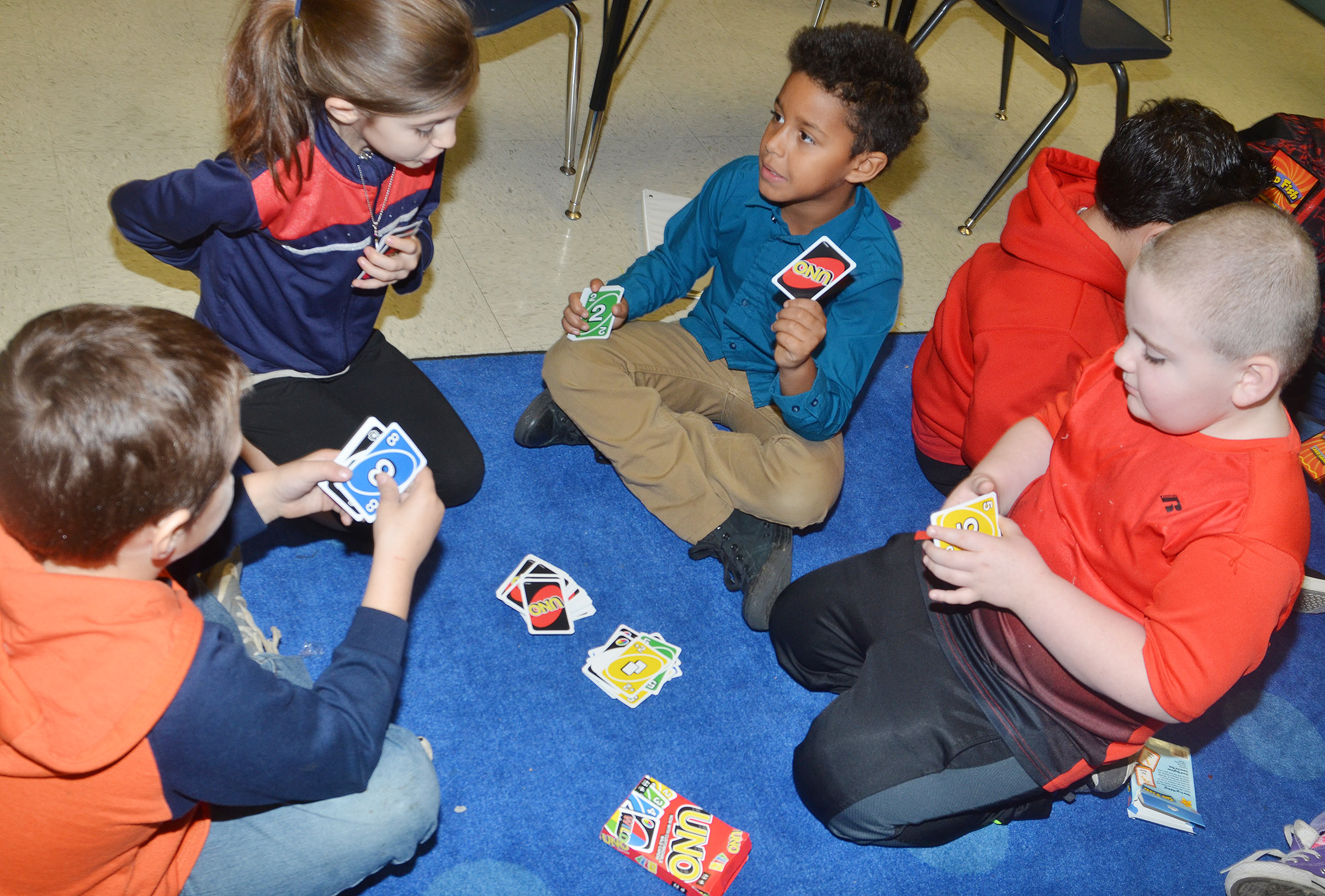 CES second-graders play Uno. From left are Jaxson Hunt, Madison Choate, Carter Bell and Drake Edwards.