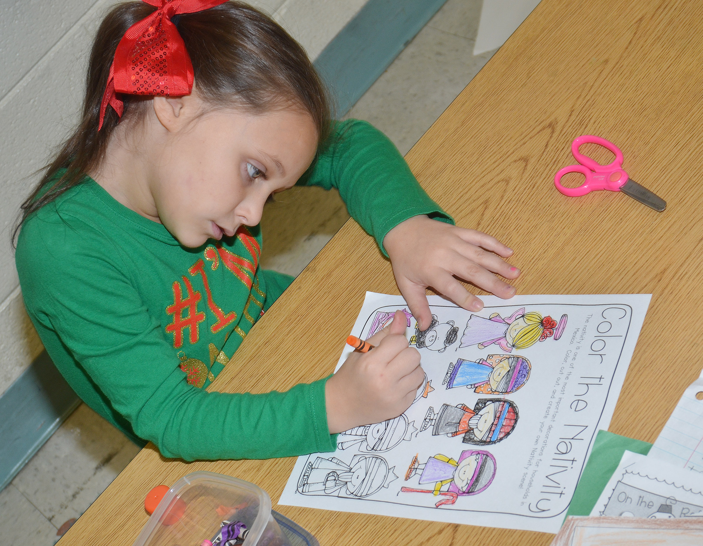 CES second-grader Serenity Taylor colors a nativity scene.