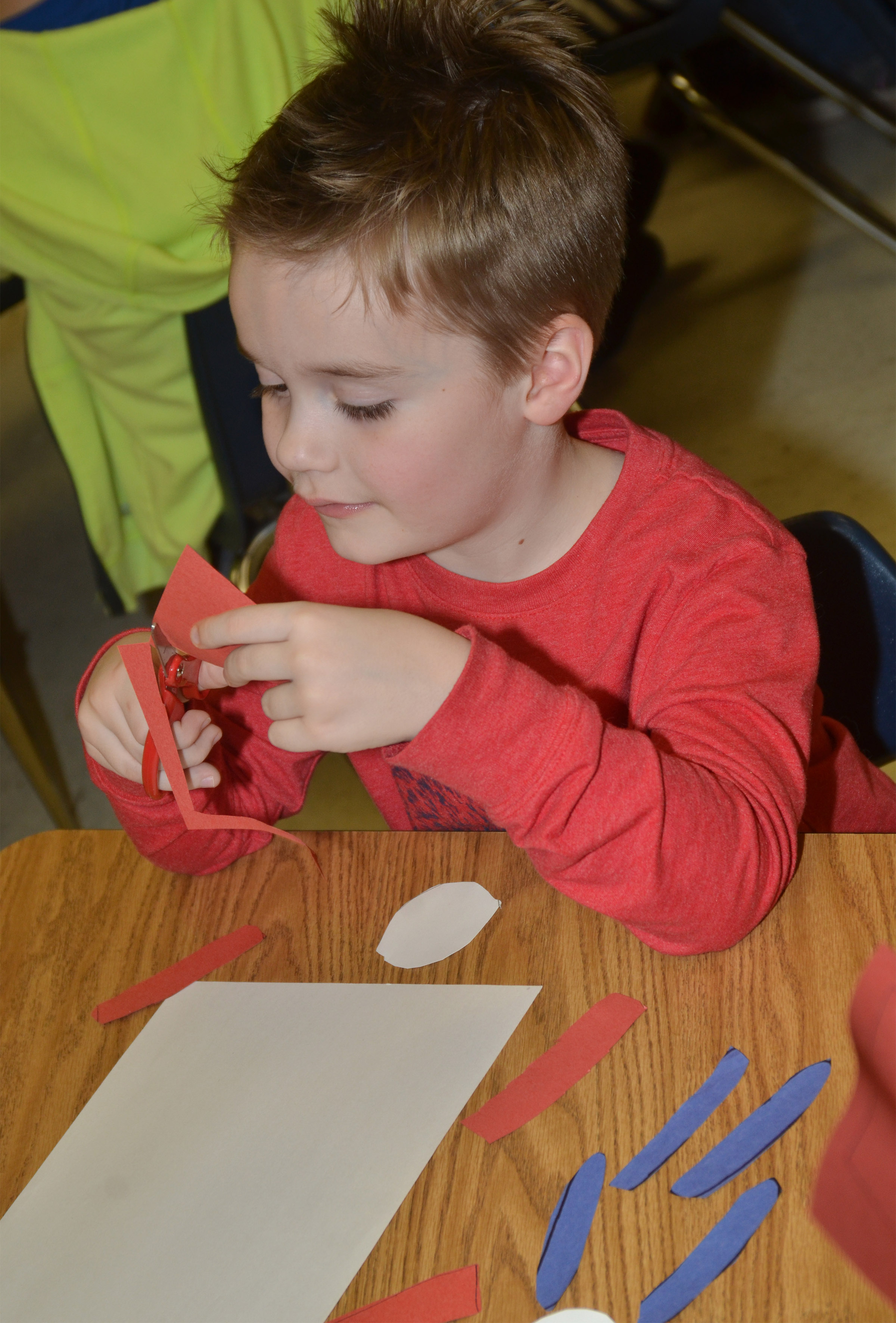CES kindergartener Gavin Williams cuts out the pieces to his Thing 1 character.