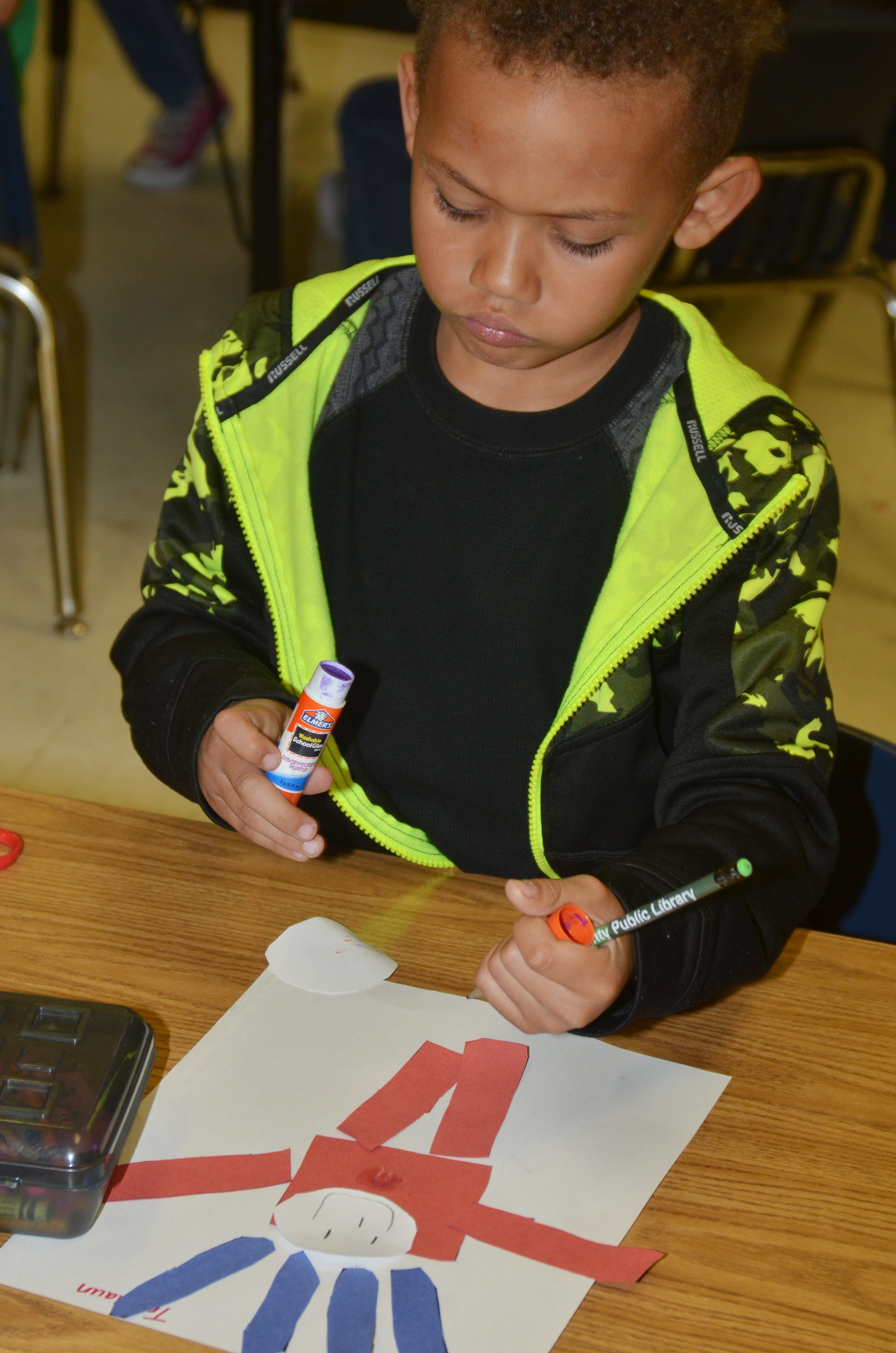 CES kindergartener Travontae Jones glues his Thing 1 character together.