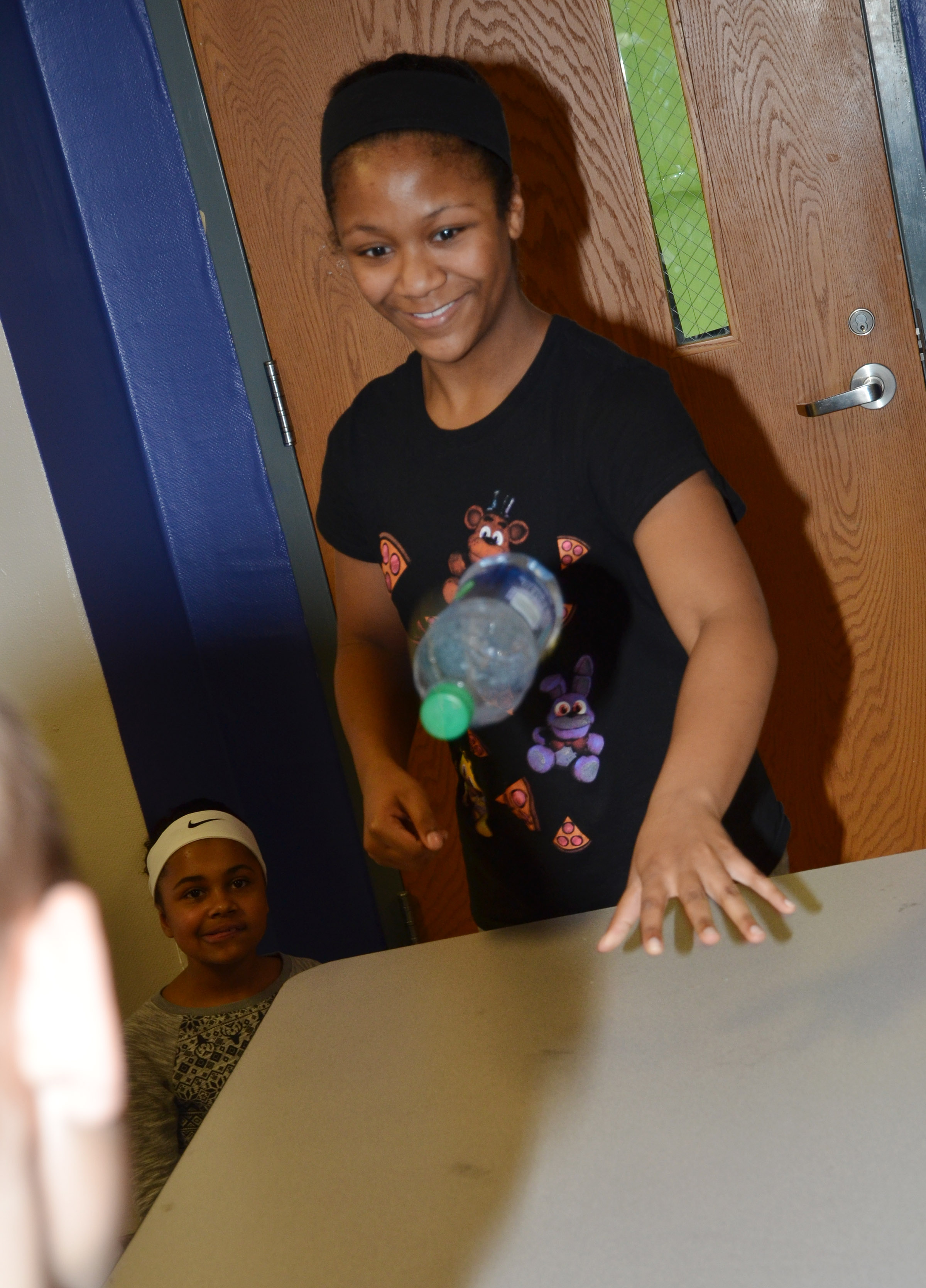 CMS fifth-grader Camilla Taylor competes in the water bottle flipping contest.