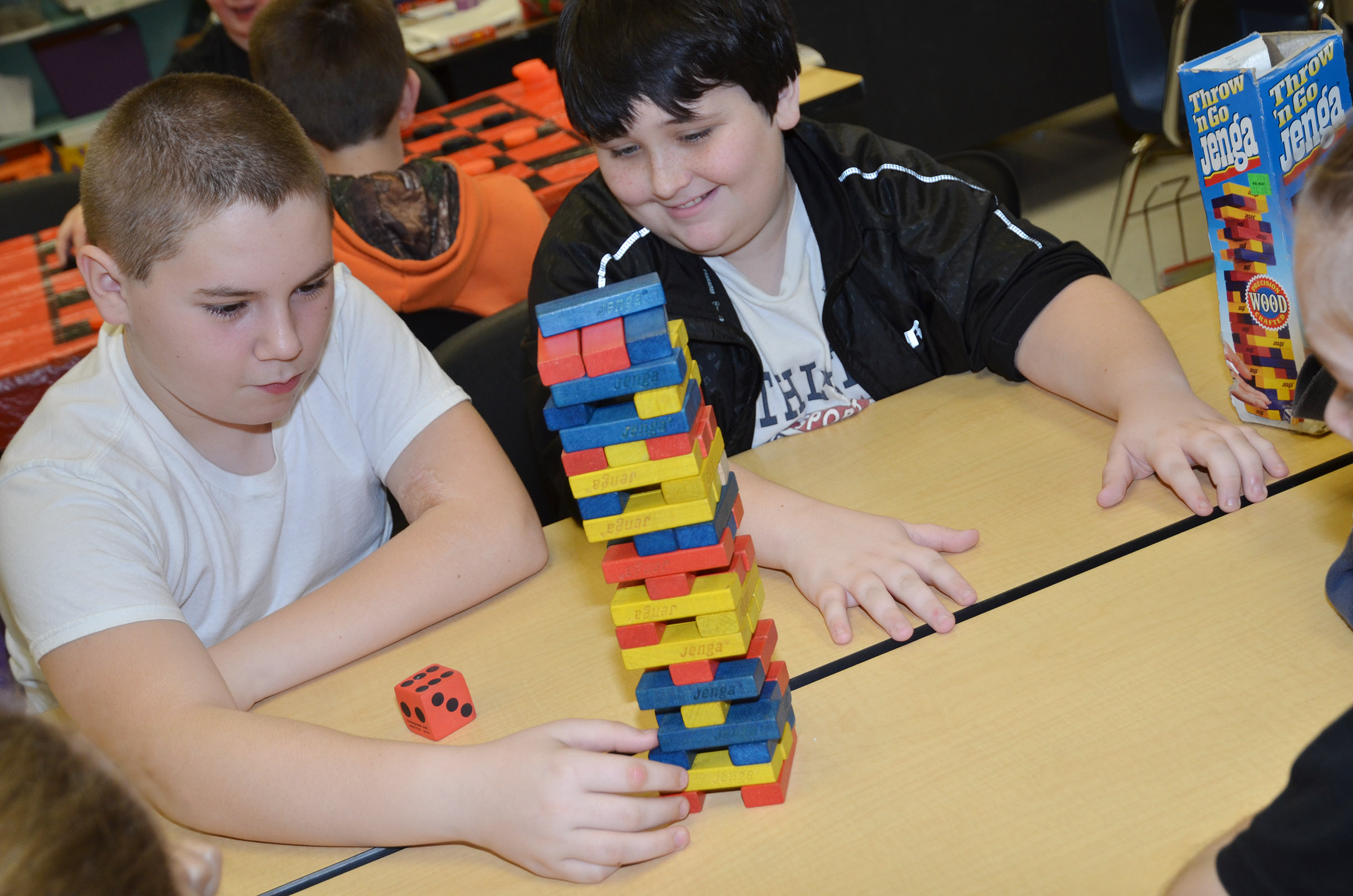 CMS fifth-graders Isaac Roddy, at left, and Miles Wright play Jenga.