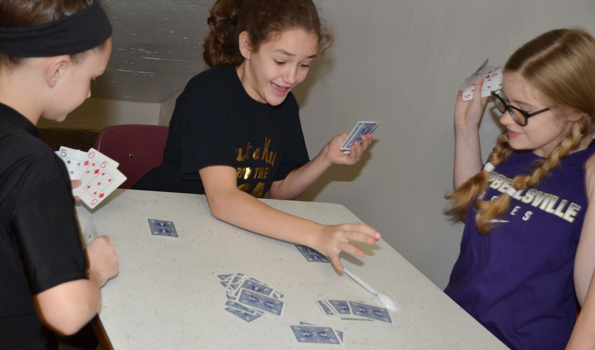 From left, CMS sixth-graders Alexis Byers, Haylee Allen and Whitney Frashure play spoons.