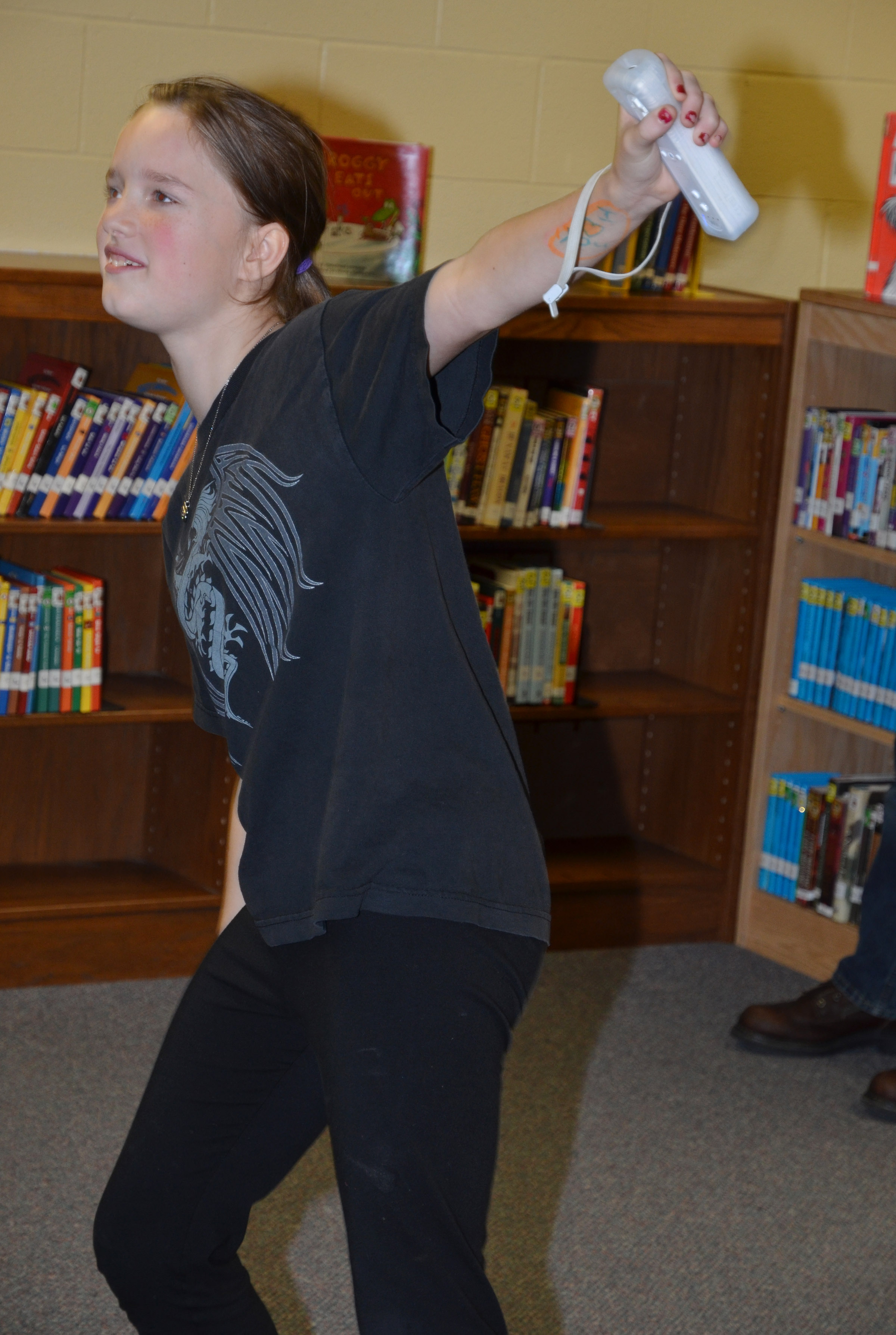 CMS sixth-grader Tonya Parker plays Wii Dance.