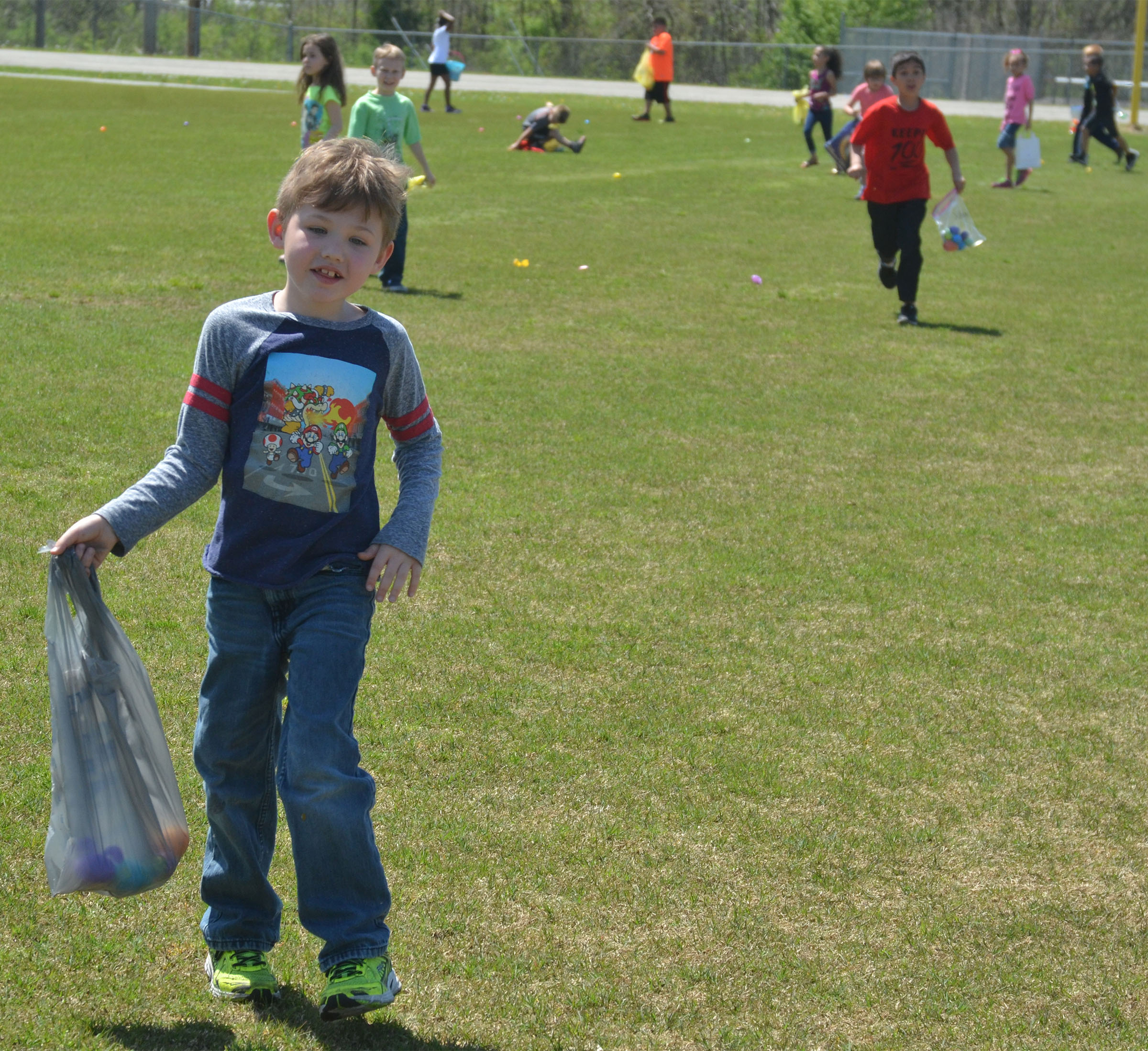 CES first-grader Lucian Abel searches for Easter eggs.