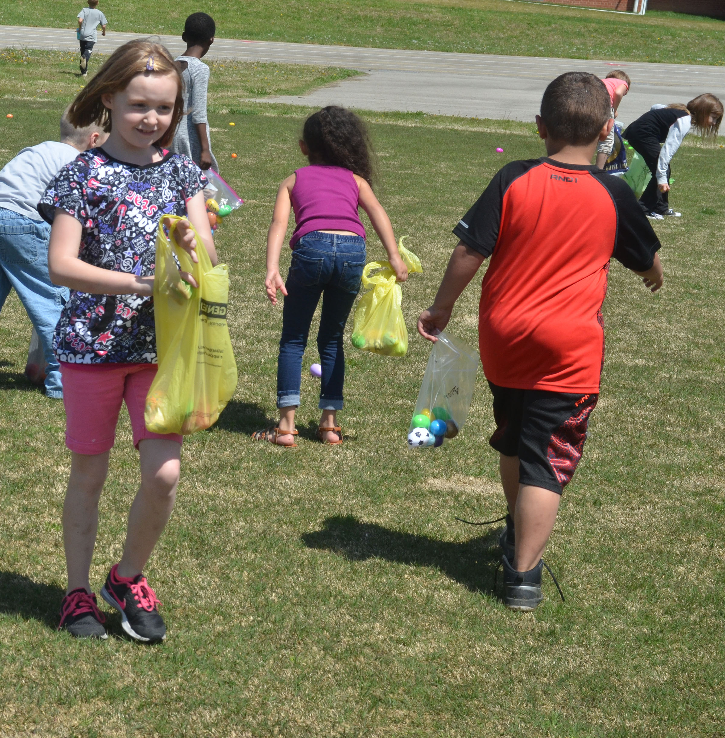 CES first-grader Gracie Murphy searches for Easter eggs.