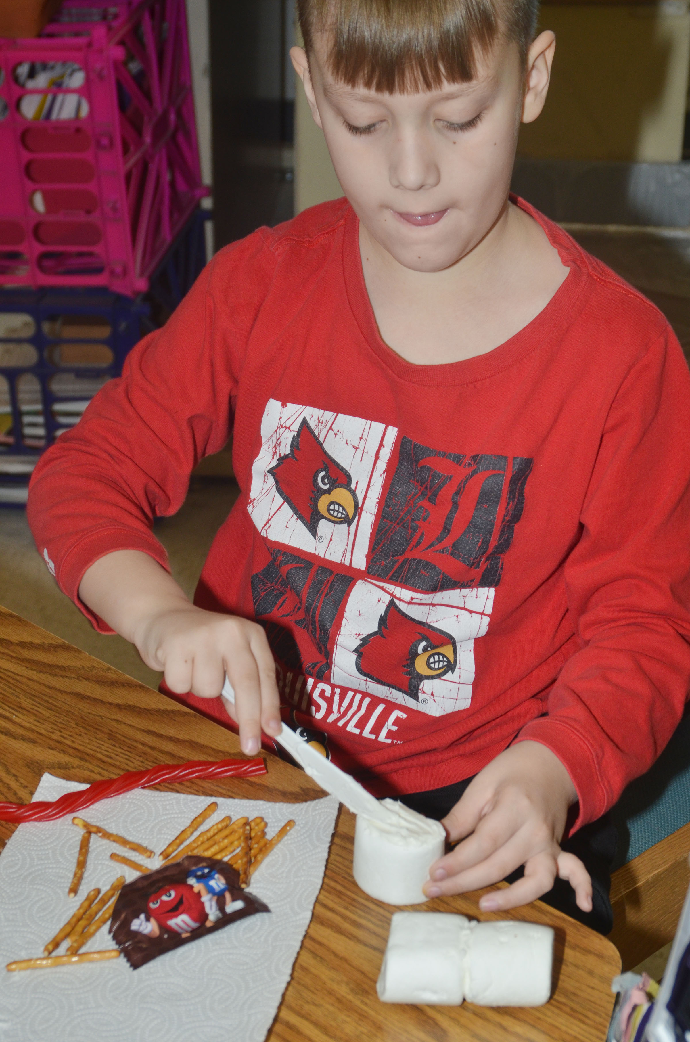 CES third-grader Izak Burress adds icing to his marshmallows.