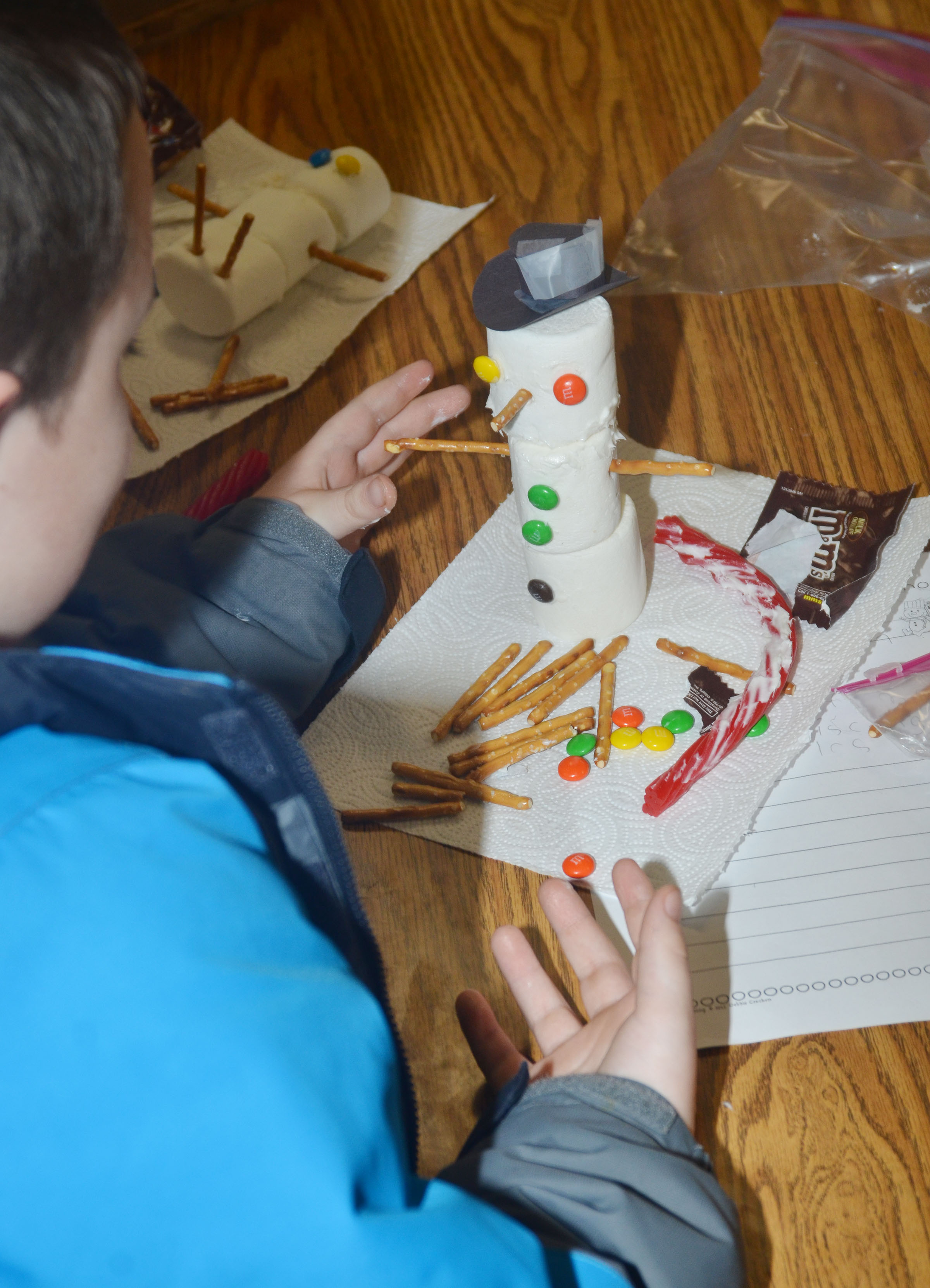 CES third-graders build their snowmen.