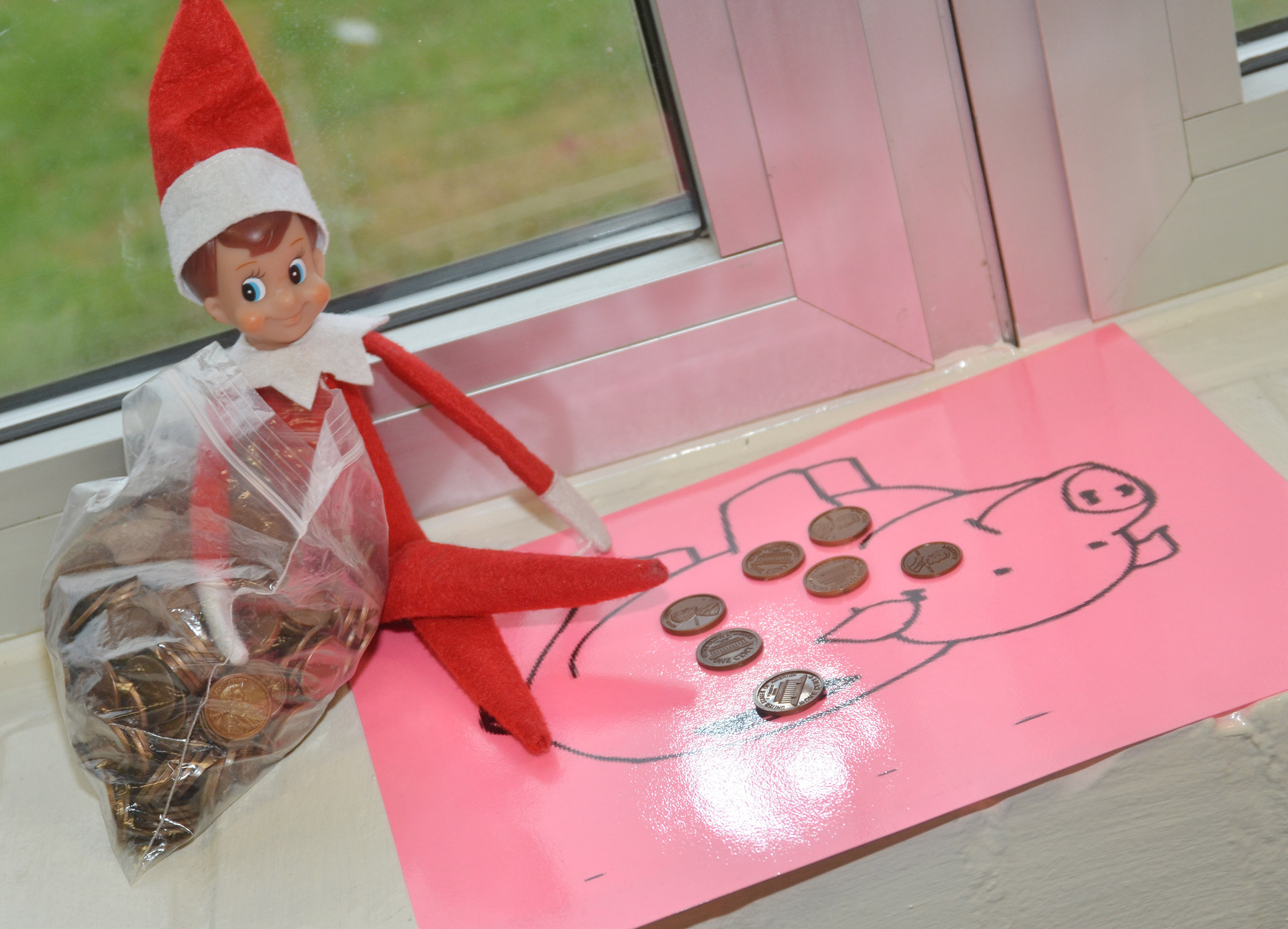 Elves recently created some messes at CES. This elf spent some time counting the class's money.