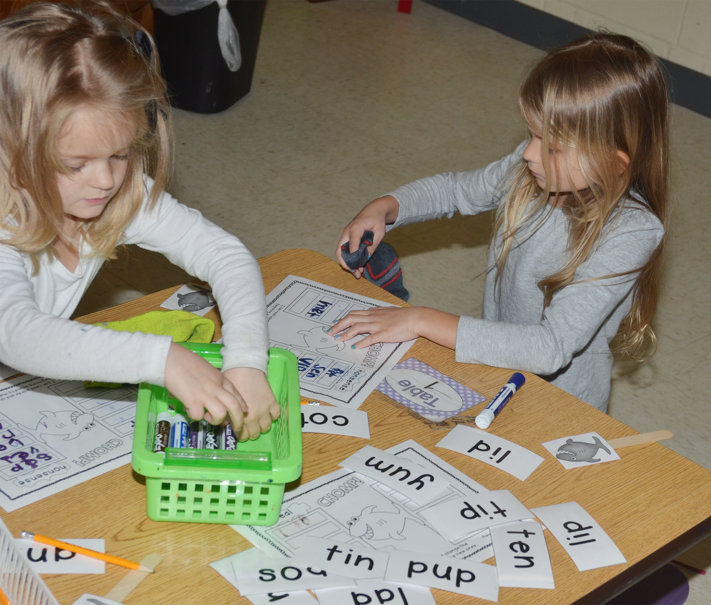 CES kindergarteners Miley Orberson, at left, and Gracie Gebler decide if the words they are spelling are real or nonsense.