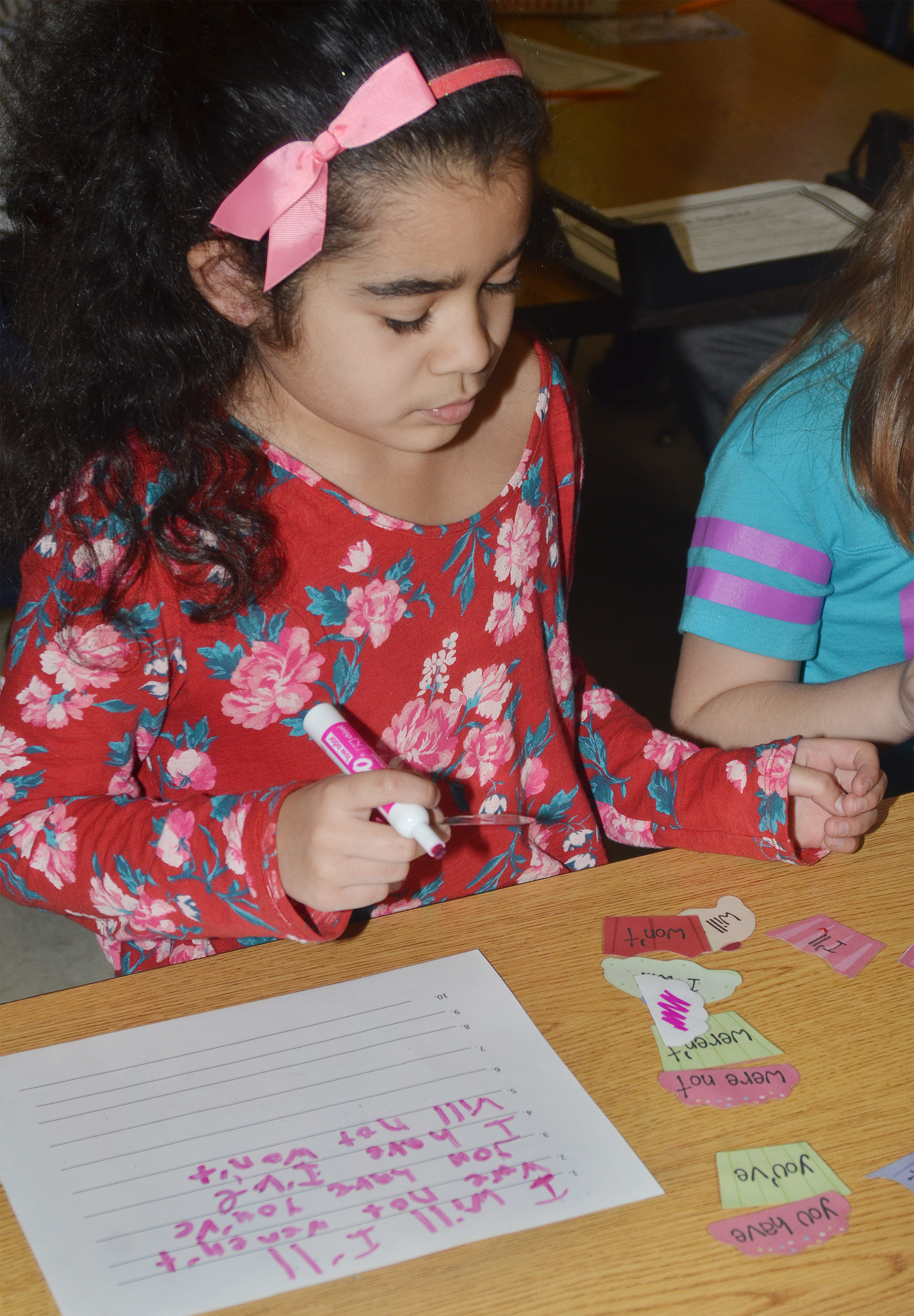 CES second-grader Sophia Santos plays the contraction cupcake game.