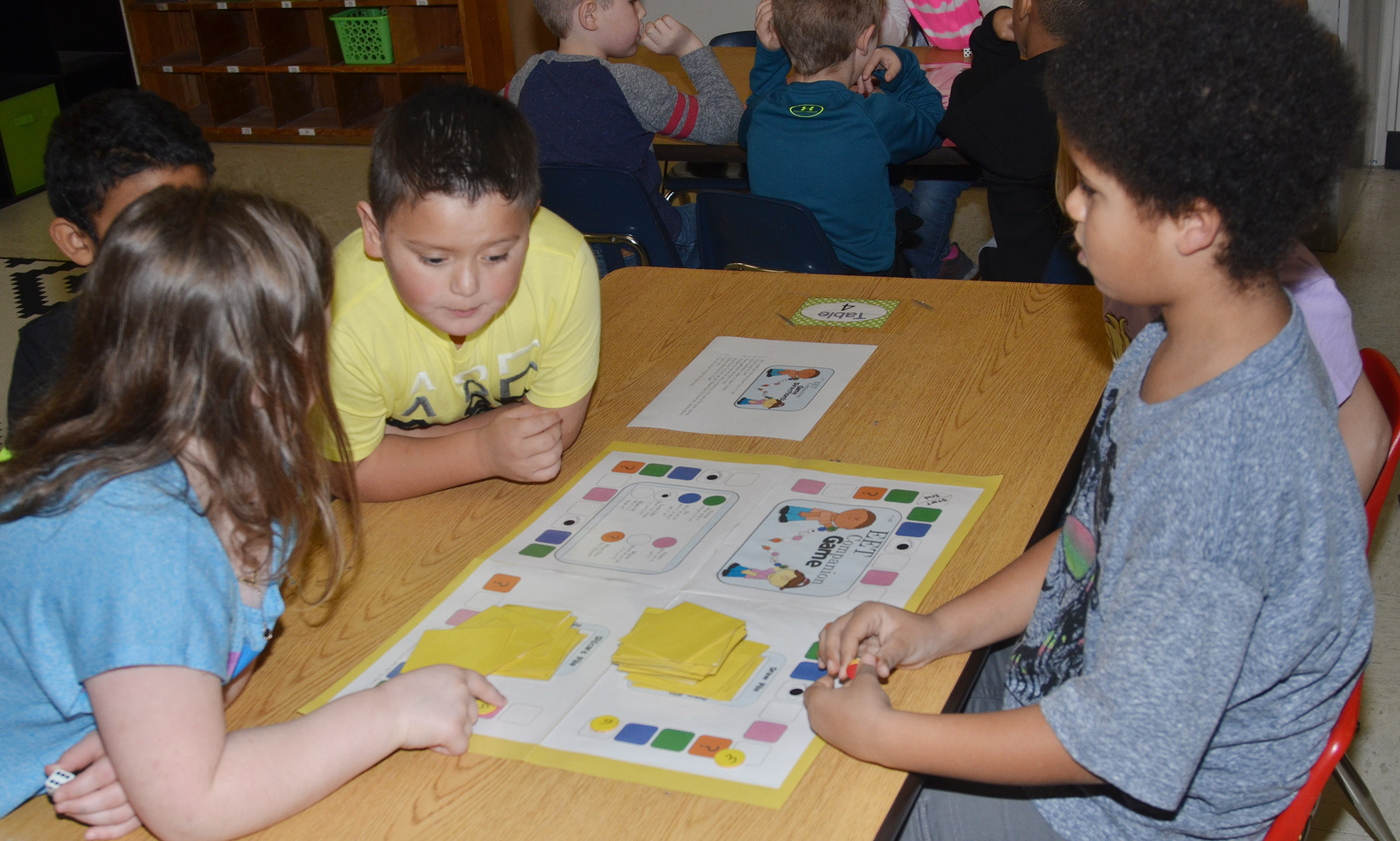 CES first-grader Navon Copeland, at right, and his classmates play a comprehension game.