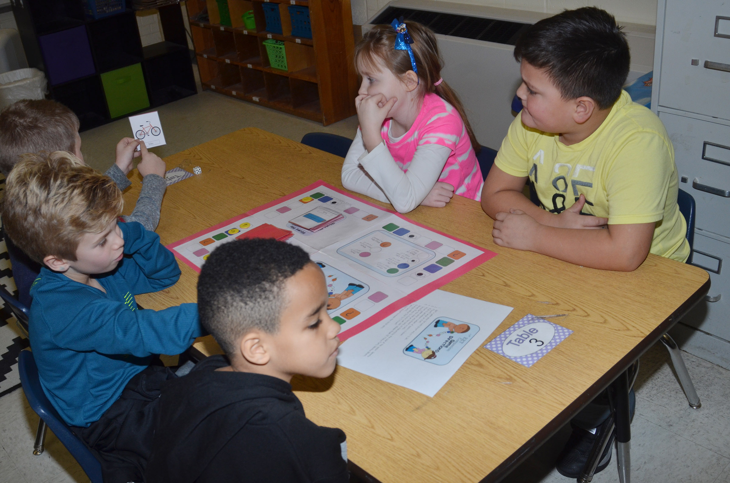CES first-graders, from left, Lucian Abel, Parker Hamilton, Austin Hamilton, Gracie Murphy and Eric Mixtega play a comprehension game.