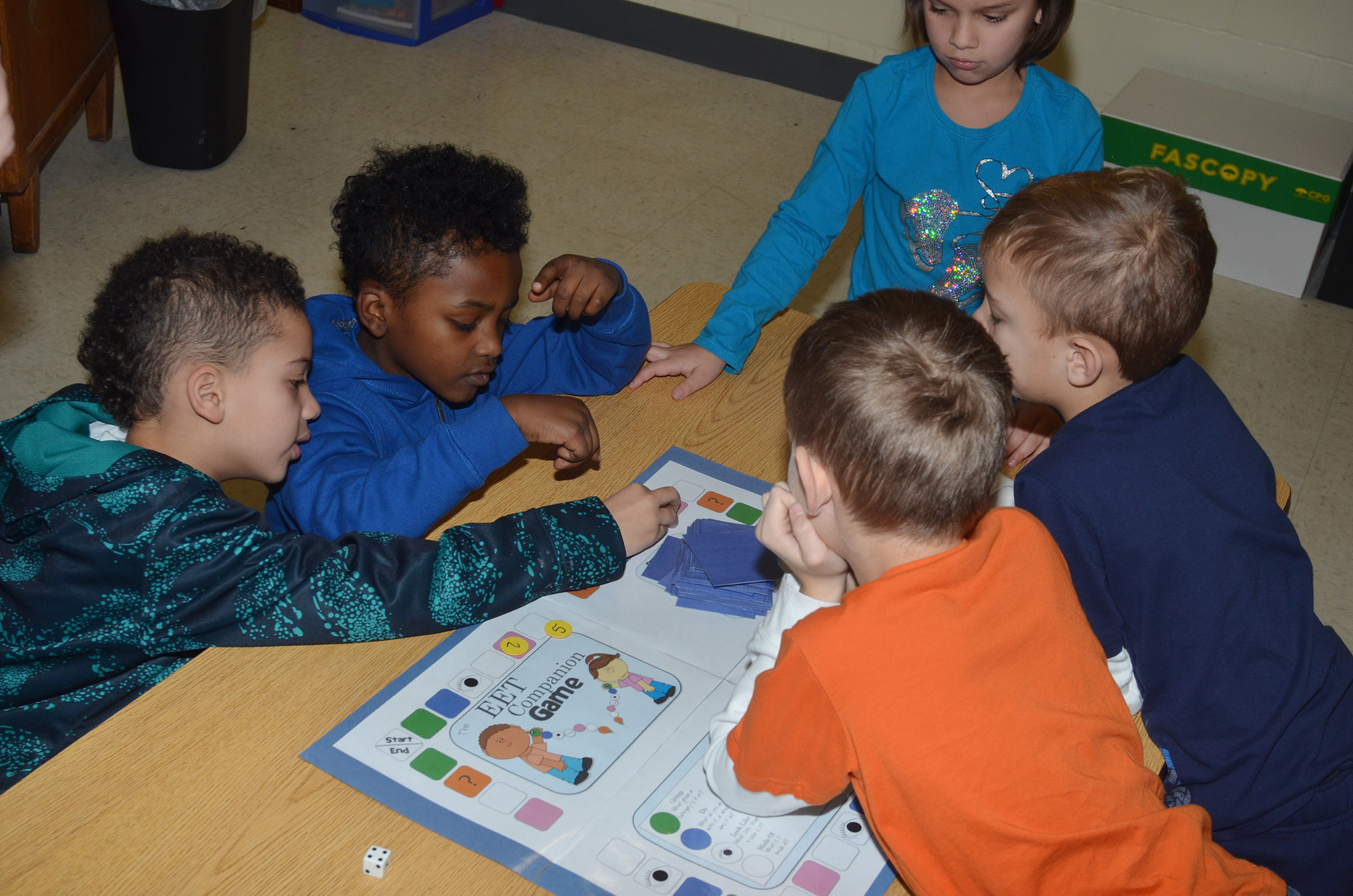 CES first-graders, clockwise from left, Bryant Mayo, Drelynn Hollins, Adriana Agent, Gabe Prior and Logan Weddle play a comprehension game.