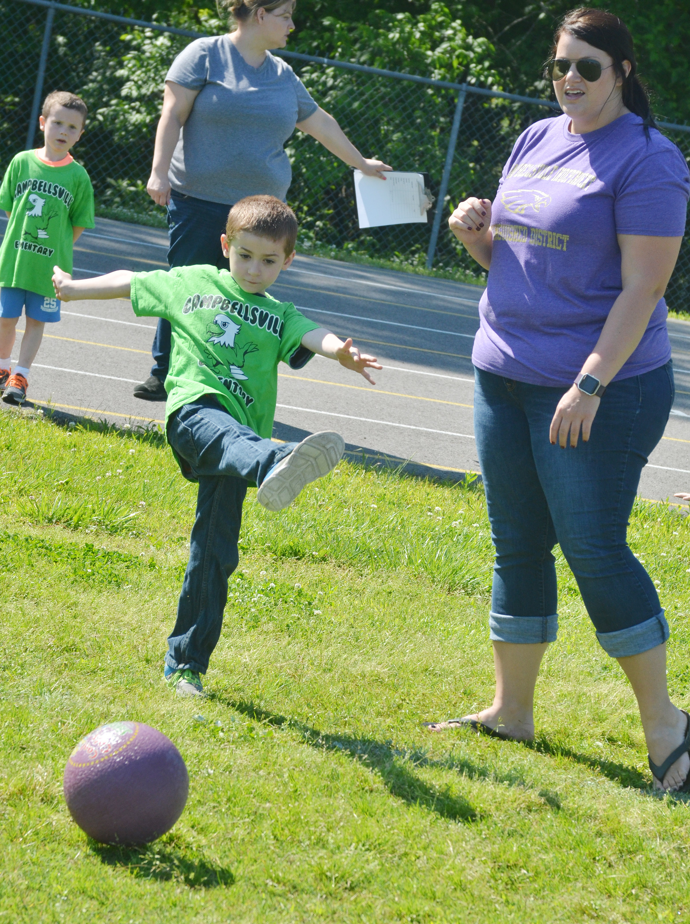 CES kindergartener Greyson Trulock kicks the ball.
