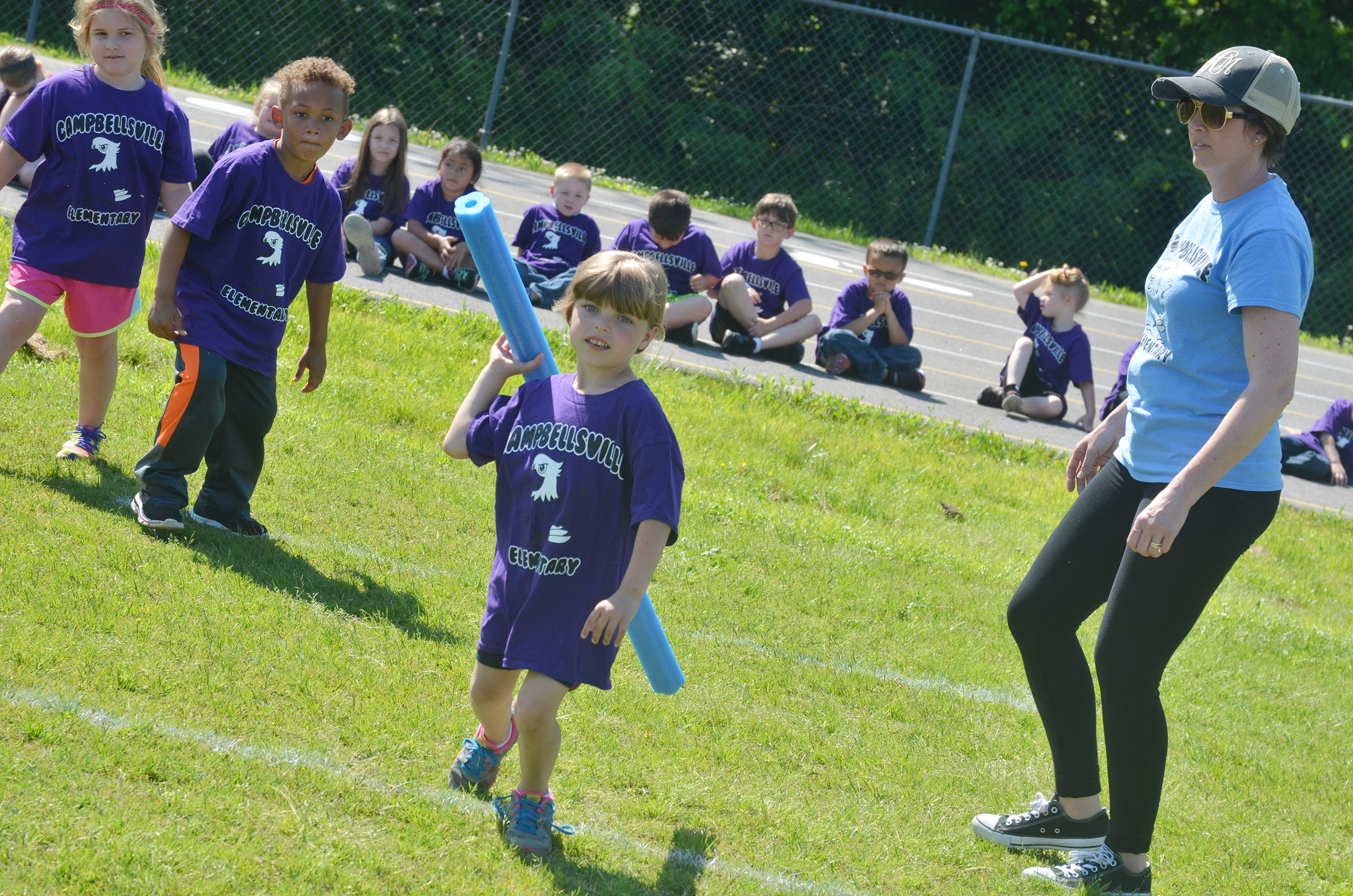 CES kindergartener Madison Wilhoite competes in the javelin.
