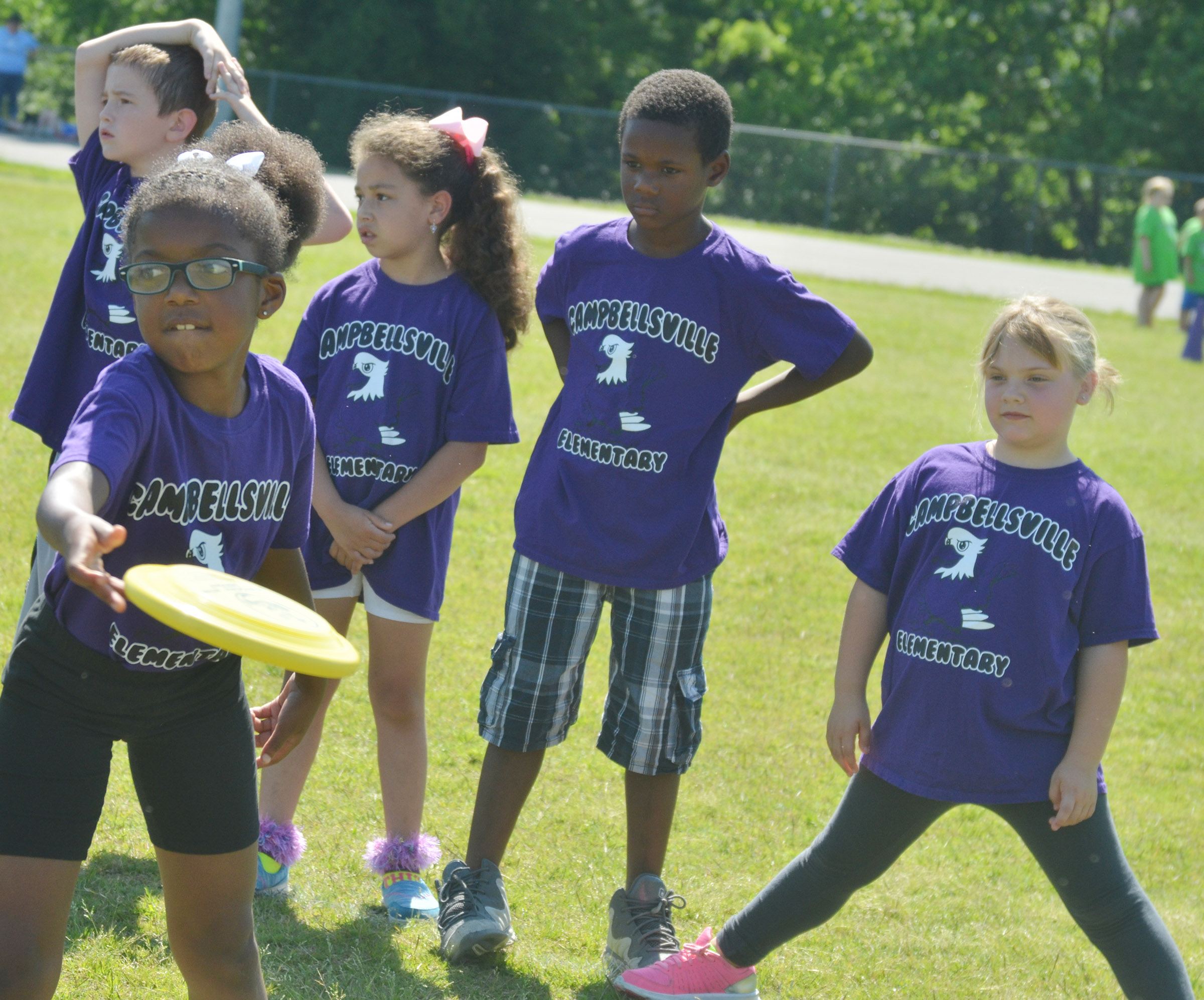 CES first-grader Willow Griffin throws a Frisbee.