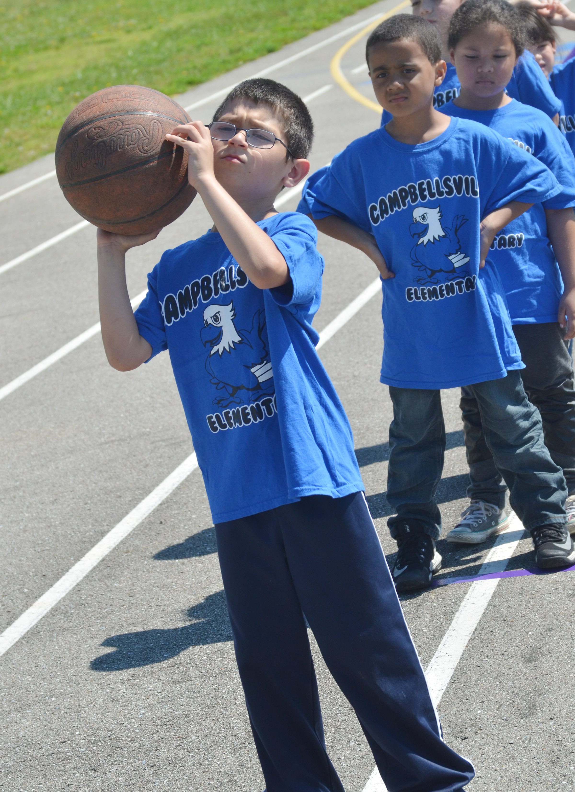 CES first-grader Henry Martinez shoots a basketball.
