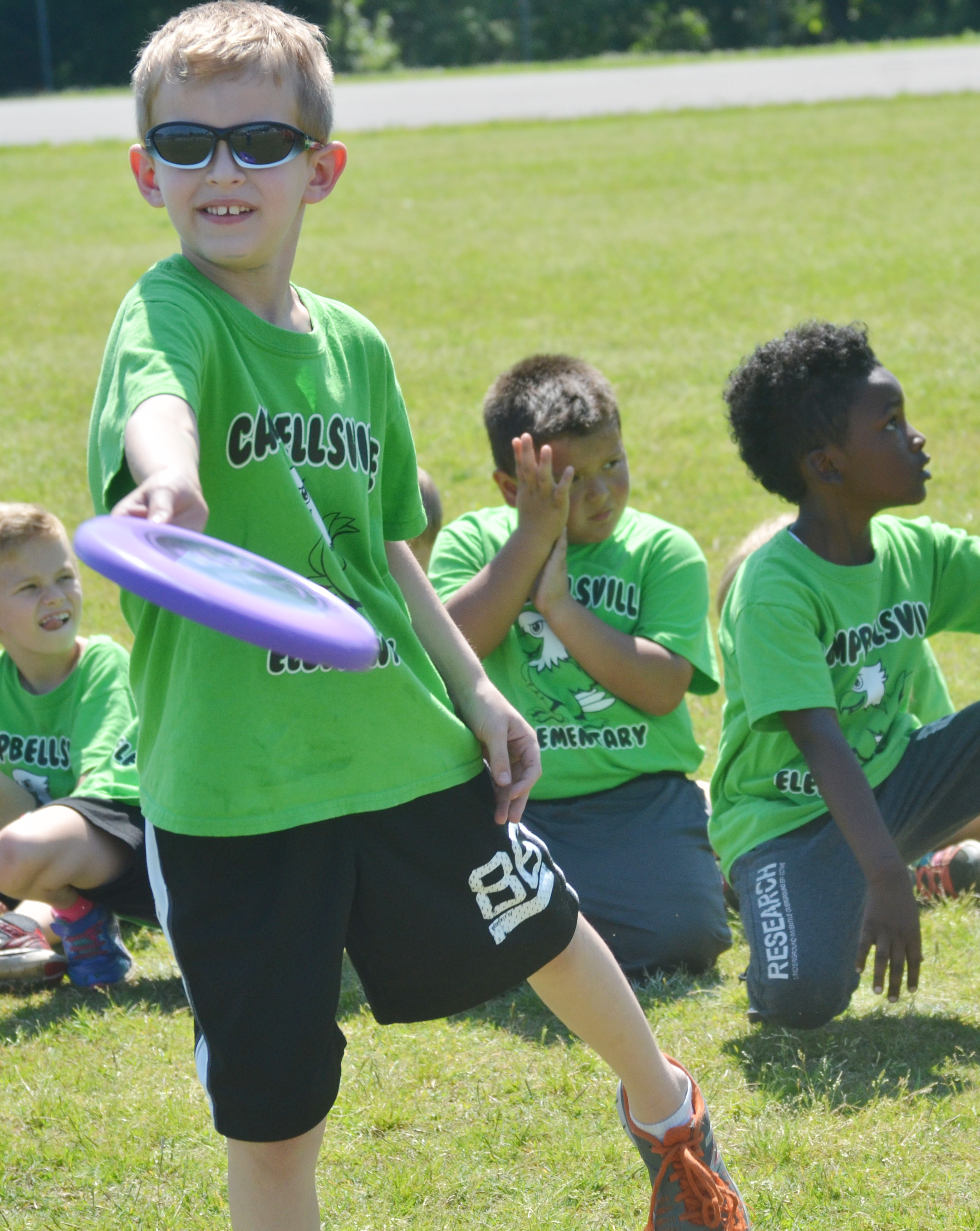 CES first-grader Logan Weddle throws a Frisbee.