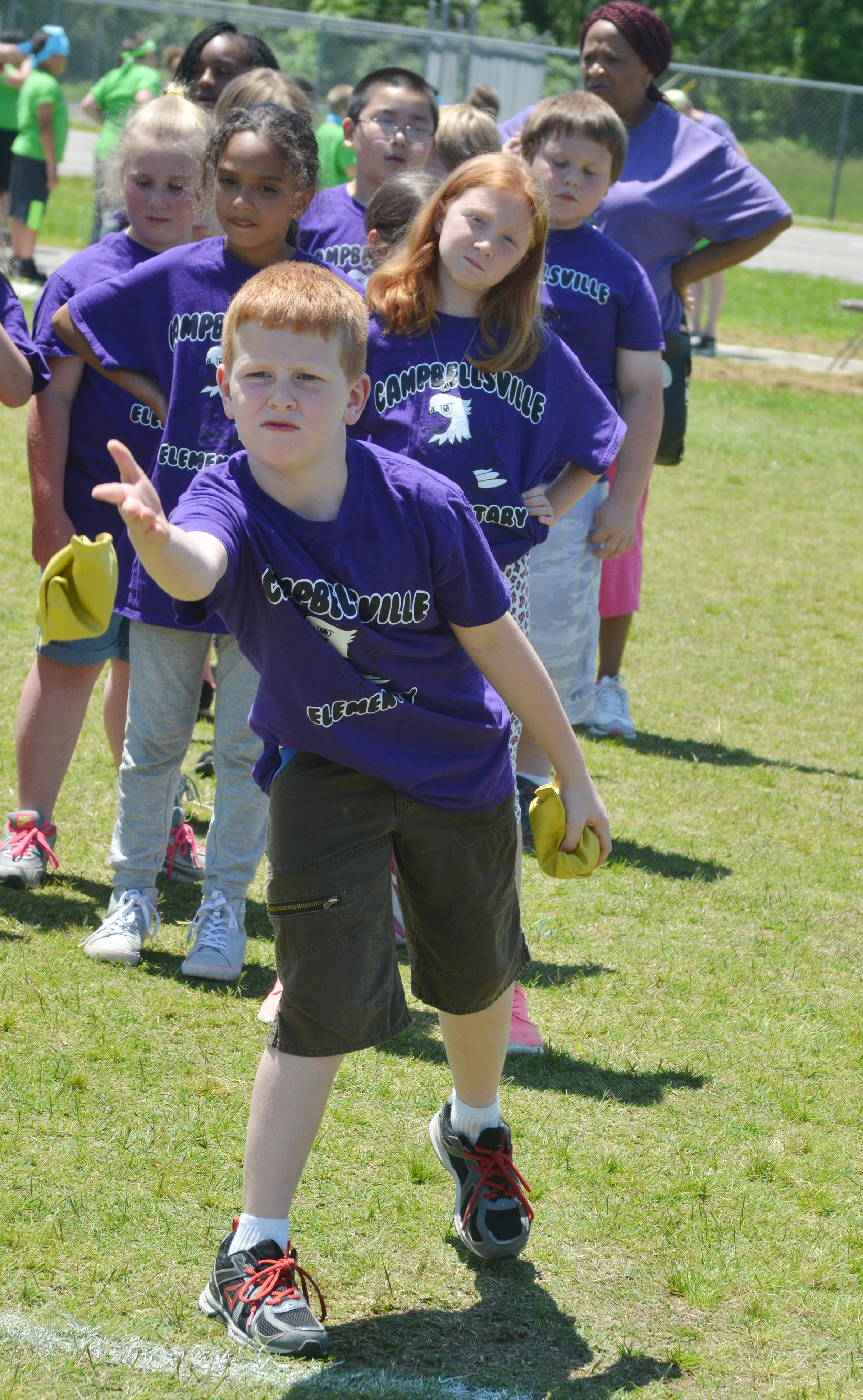 CES third-grader Westin Dudgeon throws a bean bag.