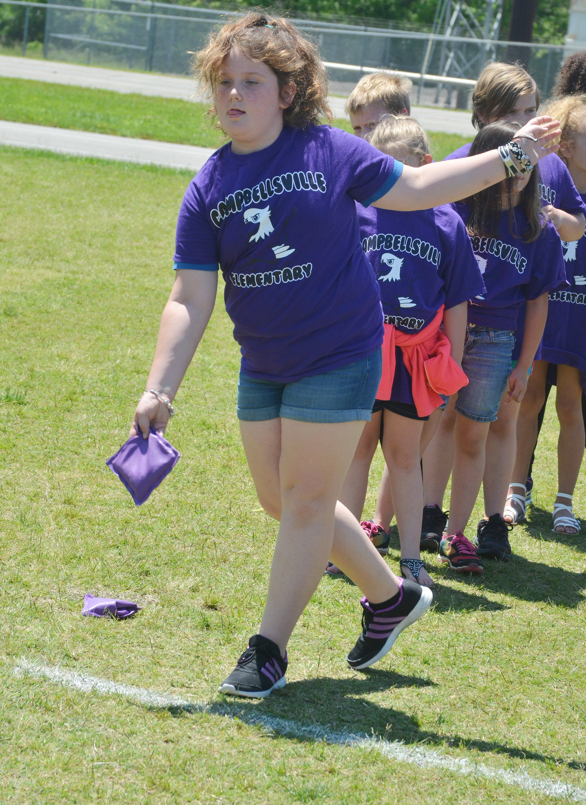CES third-grader Madison Philpott throws a bean bag.
