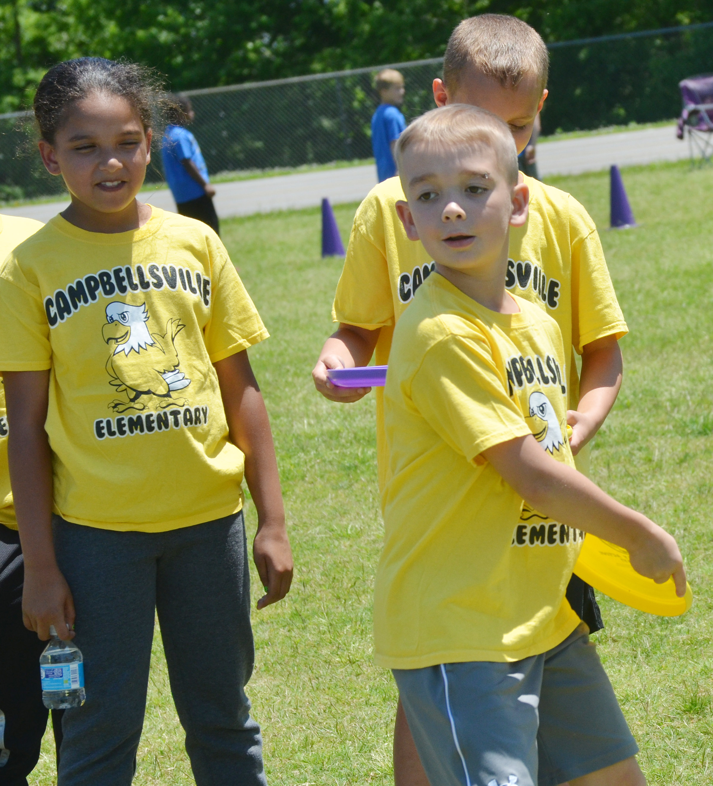 CES third-grader Cameron Estes throws a Frisbee.