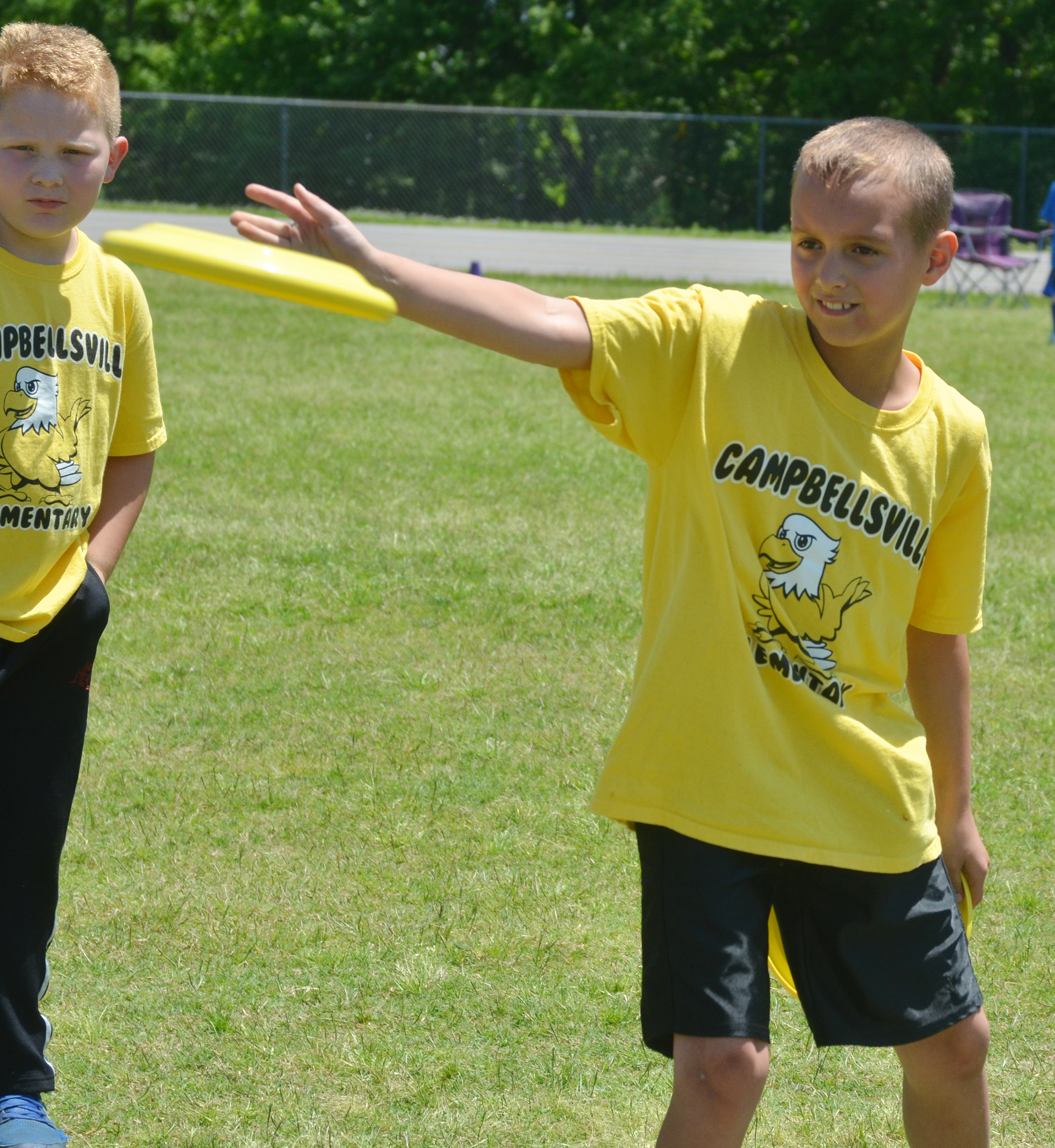 CES third-grader Bradley Paris throws a Frisbee.