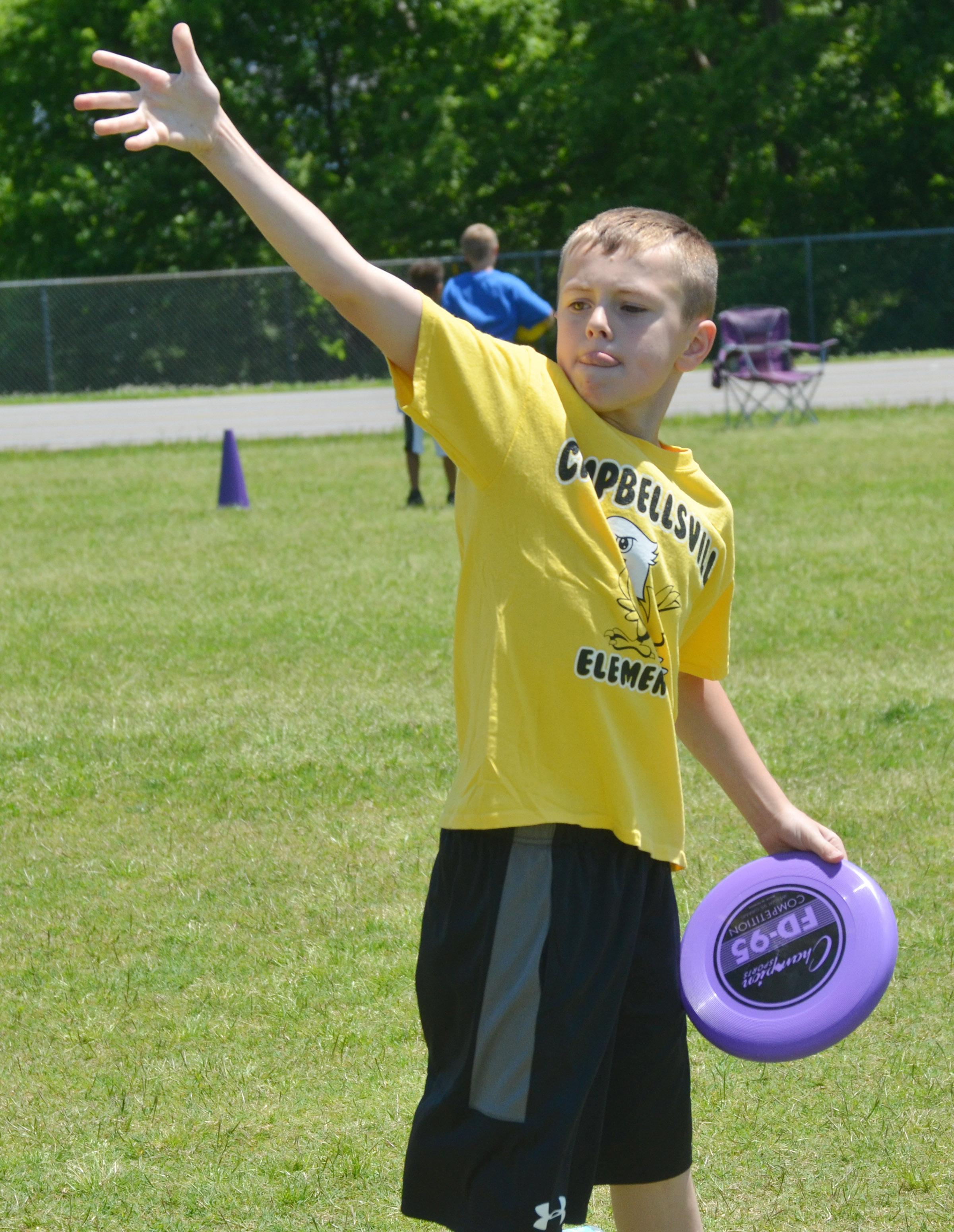 CES third-grader Keaton Hord throws a Frisbee.