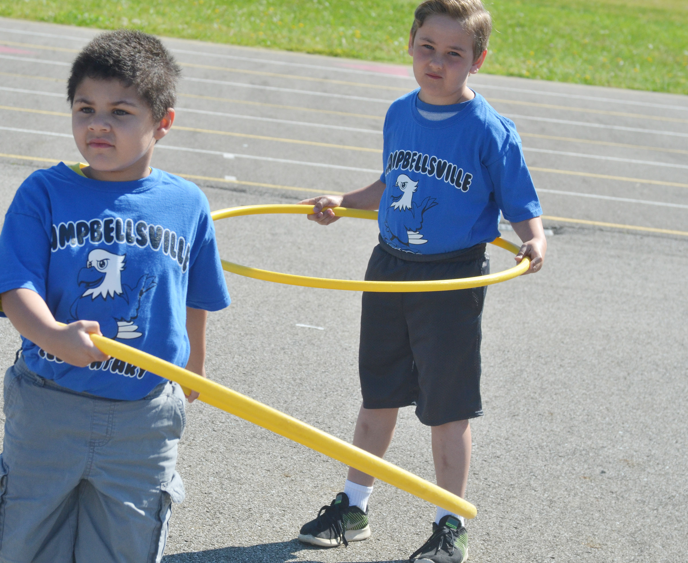 CES kindergarteners NyJah Vaught, at left, and Braxton Rhodes get set for the hula hoop competition.