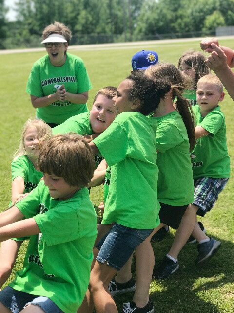 CES second-grade teacher Lynne Horn cheers for her students as they compete in tug of war.